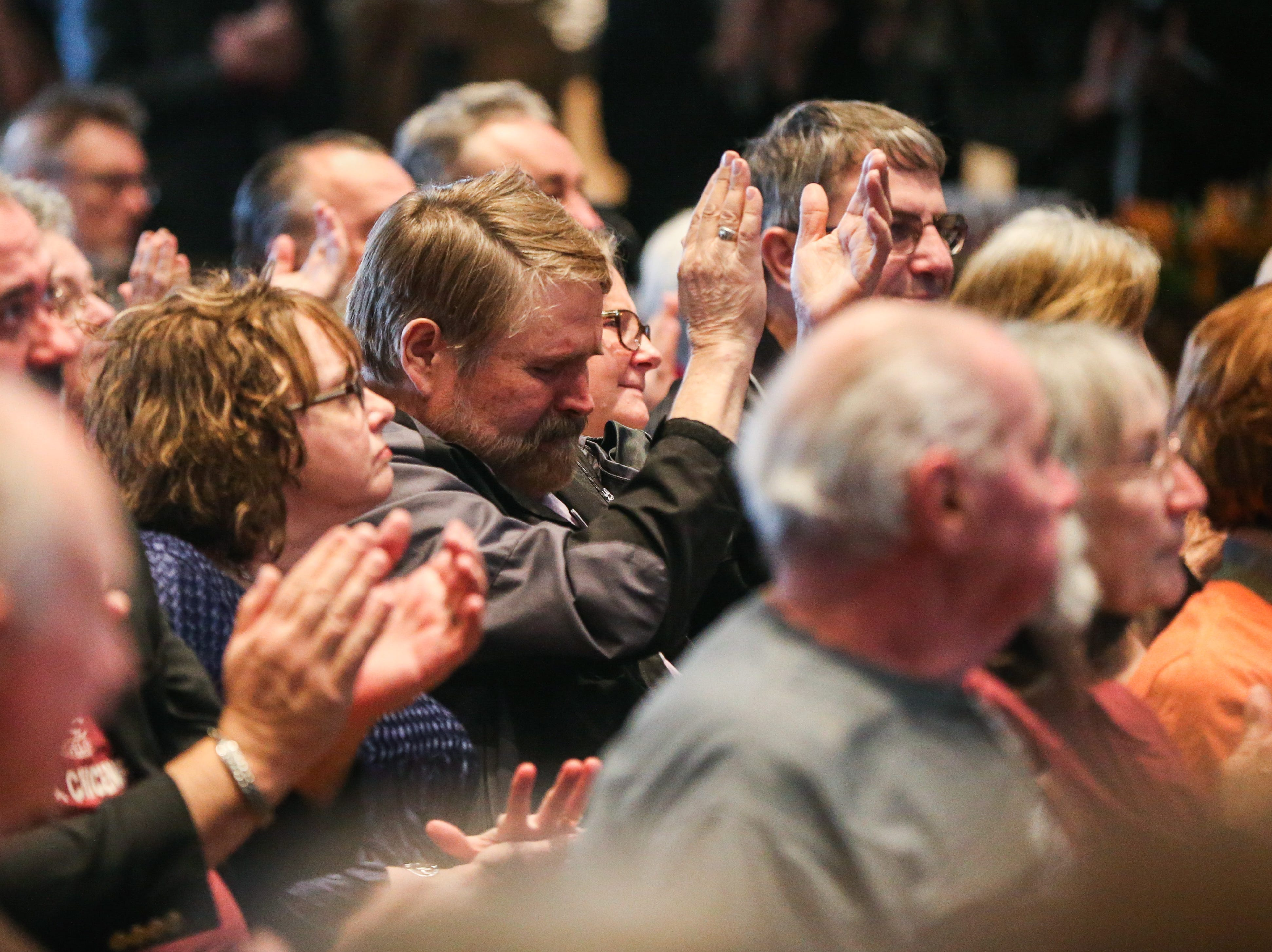 Family and friends react to a tribute by Howard Taylor during the Celebration of Spirit for Roger Allen Sunday, Jan. 13, 2019, at San Angelo Museum of Fine Arts.