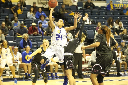 Angelo State University's Dezirae Hampton puts up a shot against West Texas A&M during a Lone Star Conference basketball game at the Junell Center on Saturday, Jan. 12, 2019.
