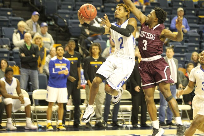 Angelo State University's Kiair Crouch (2) puts up a shot as West Texas A&M's Brandon Hall defends on the play during a Lone Star Conference basketball game at the Junell Center on Saturday, Jan. 12, 2019. West Texas won 89-78.