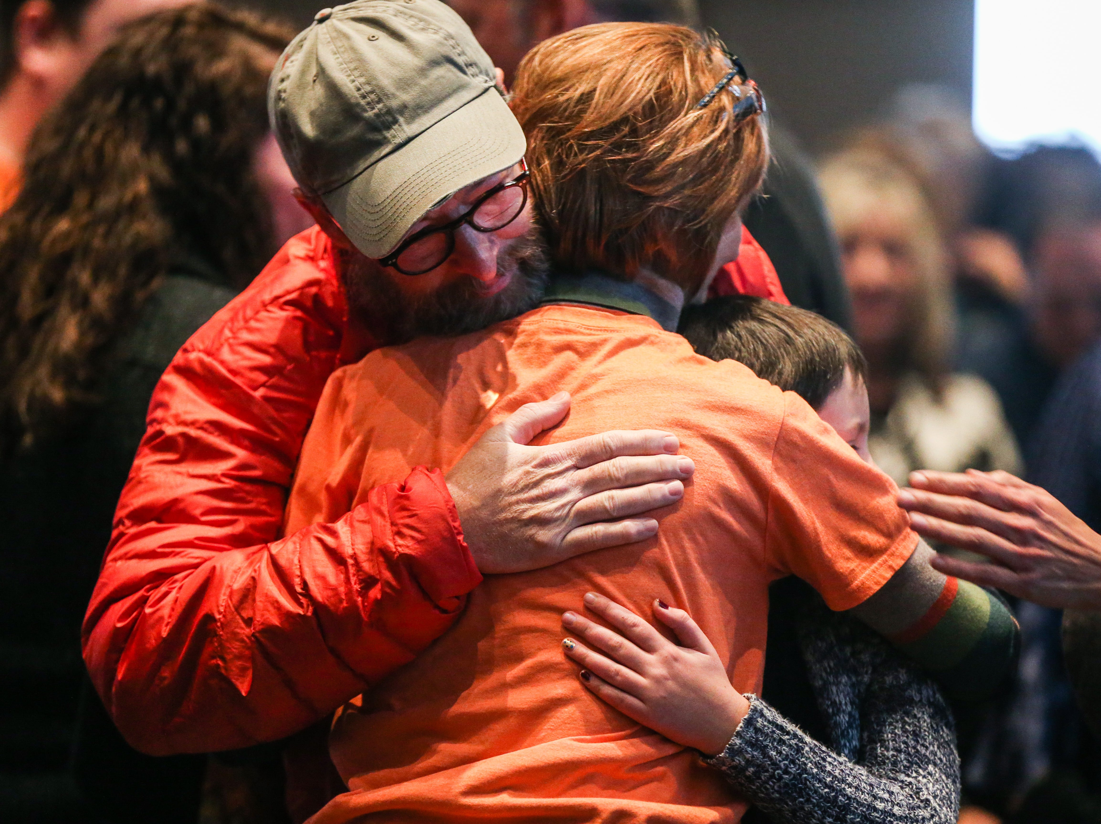Attendees hug Pam Bladine after the Celebration of Spirit for Roger Allen Sunday, Jan. 13, 2019, at San Angelo Museum of Fine Arts.