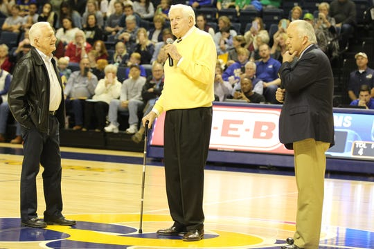 """Former Angelo State University men's basketball coach Phil George (center) was honored by having the floor at the Junell Center named the """"Phil George Center Court"""" on Saturday, Jan. 12, 2019. F.L. """"Steve"""" Stephens (left) and ASU president Brian May presented him with the honor."""