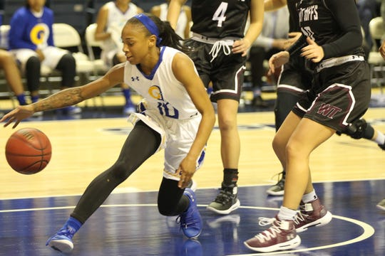 Angelo State University's Marquita Daniels tries to maintain control of the ball against West Texas A&M during a Lone Star Conference basketball game at the Junell Center on Saturday, Jan. 12, 2019.