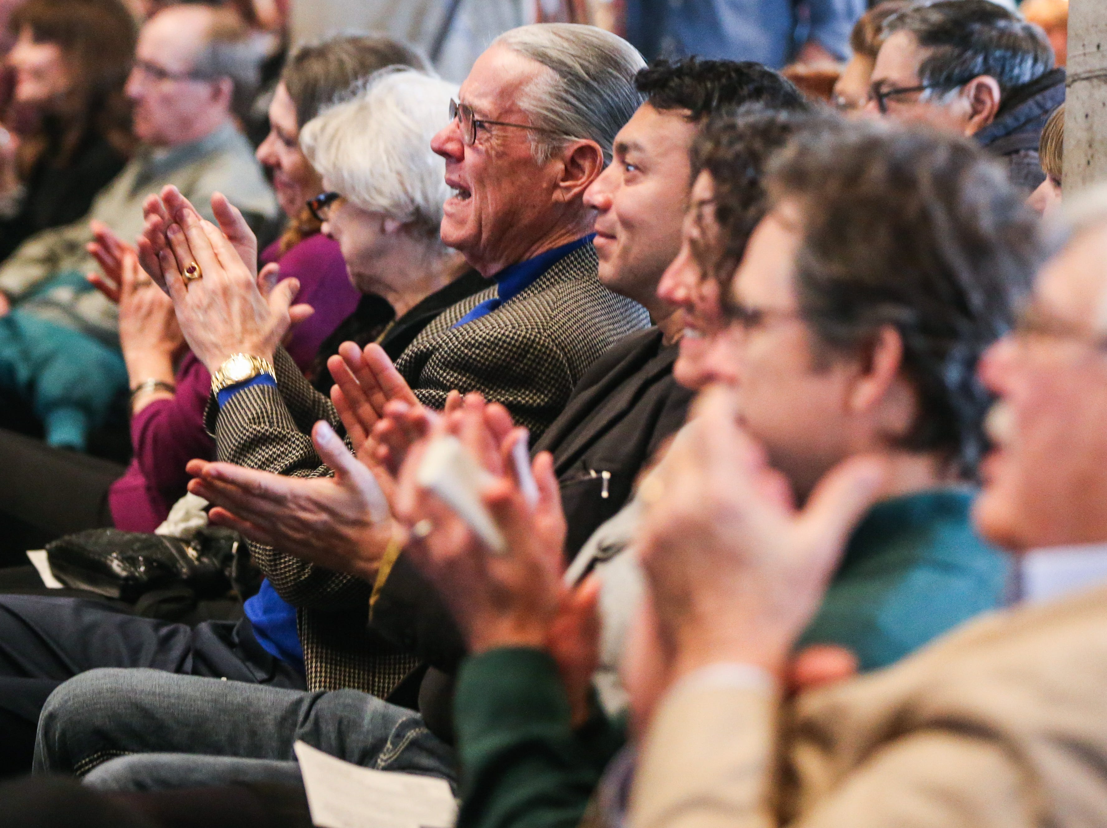 Attendees react to a speaker during the Celebration of Spirit for Roger Allen Sunday, Jan. 13, 2019, at San Angelo Museum of Fine Arts.