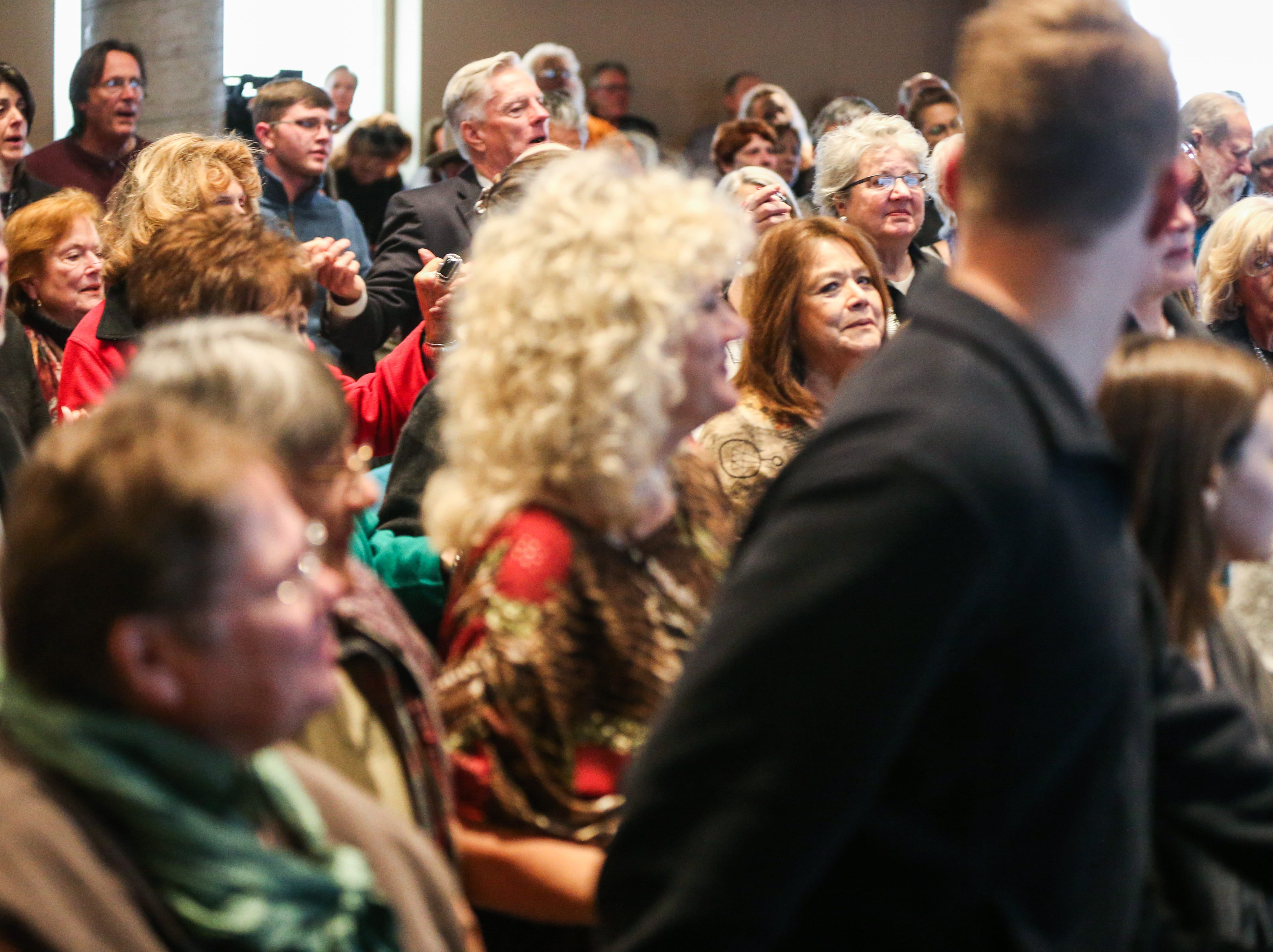 Everyone held hands during a song for the Celebration of Spirit for Roger Allen Sunday, Jan. 13, 2019, at San Angelo Museum of Fine Arts.