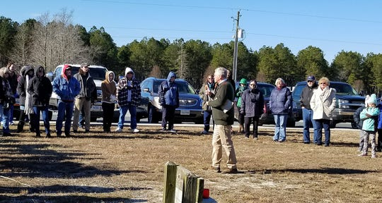 Ed Clark of the Wildlife Center of VIrginia speaks to a crowd gathered to watch an eagle be released at Tall Pines Harbor Campground in Accomack County, Virginia on Friday, Jan. 11, 2019.