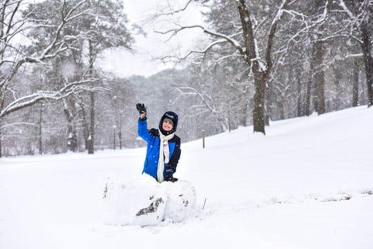 John Williams III plays in the snow at Salisbury City Park on Sunday, Jan. 13, 2019.