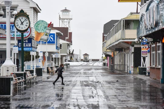 Snow turns to rain and slush on the boardwalk in Ocean City on Sunday, Jan. 13, 2019.