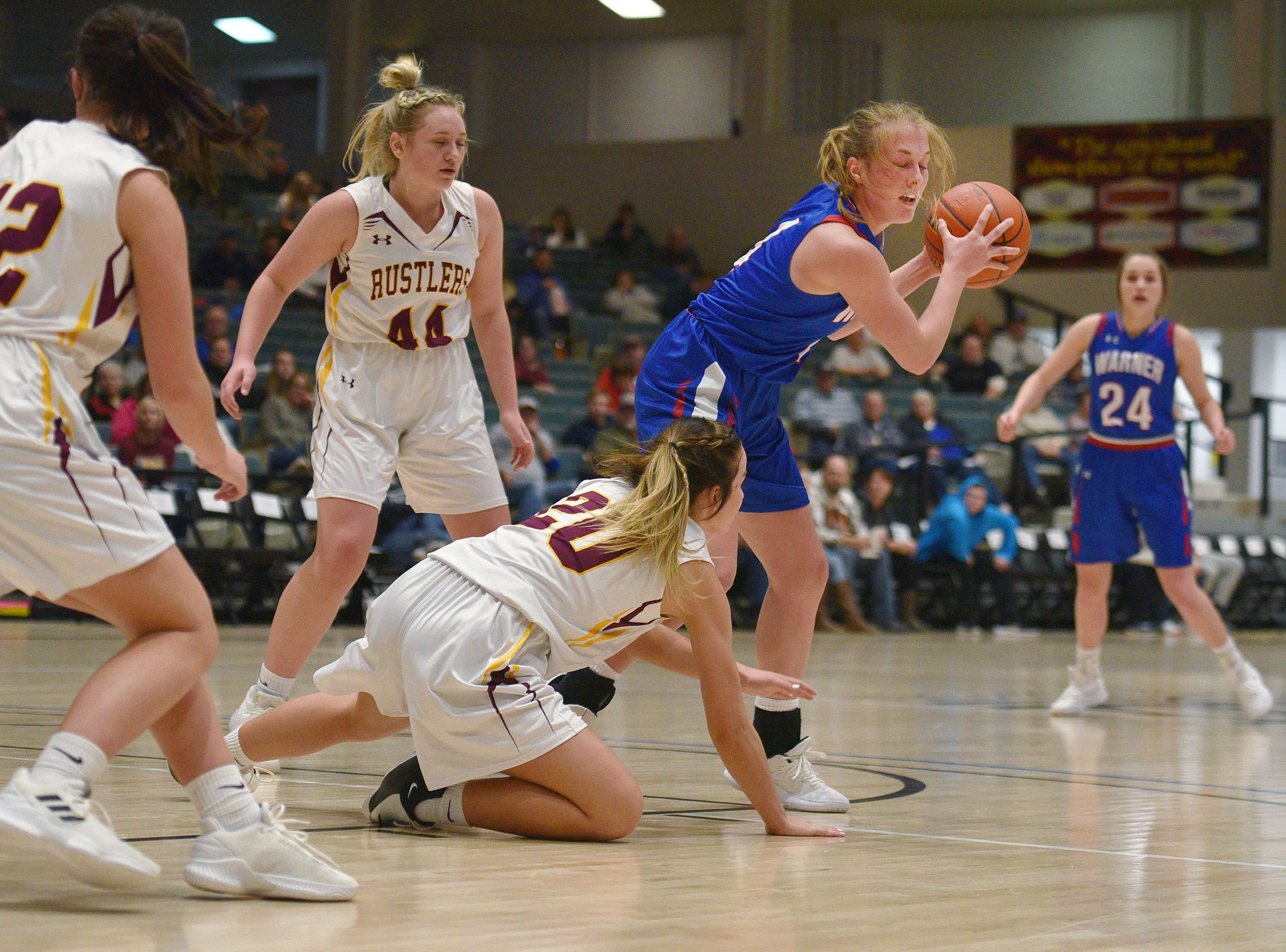 Warner's Sydney Leidholt attempts to gain control of the ball against Ethan defense in the Hanson Girls Classic Saturday,  Jan. 12, in Mitchell.