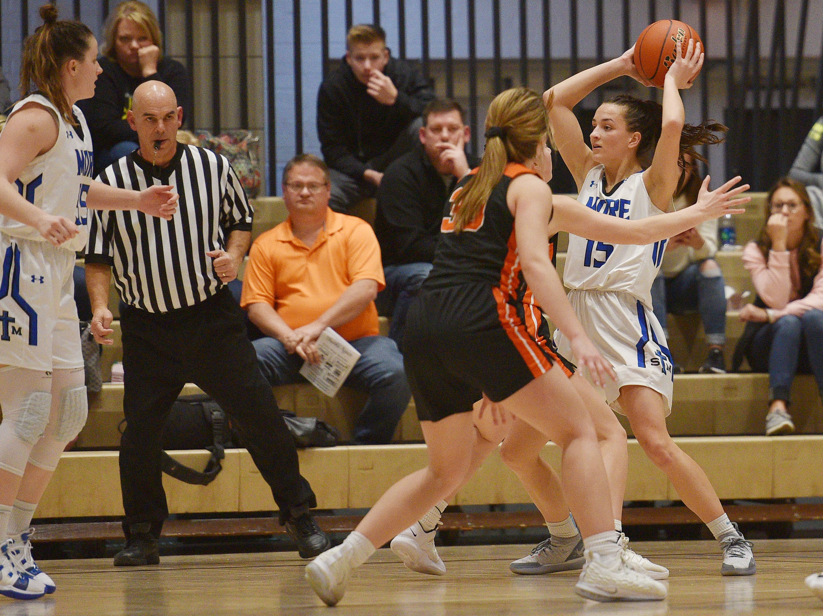 St. Thomas More's Ciara Benson goes against Lennox defense in the Hanson Girls Classic Saturday,  Jan. 12, in Mitchell.