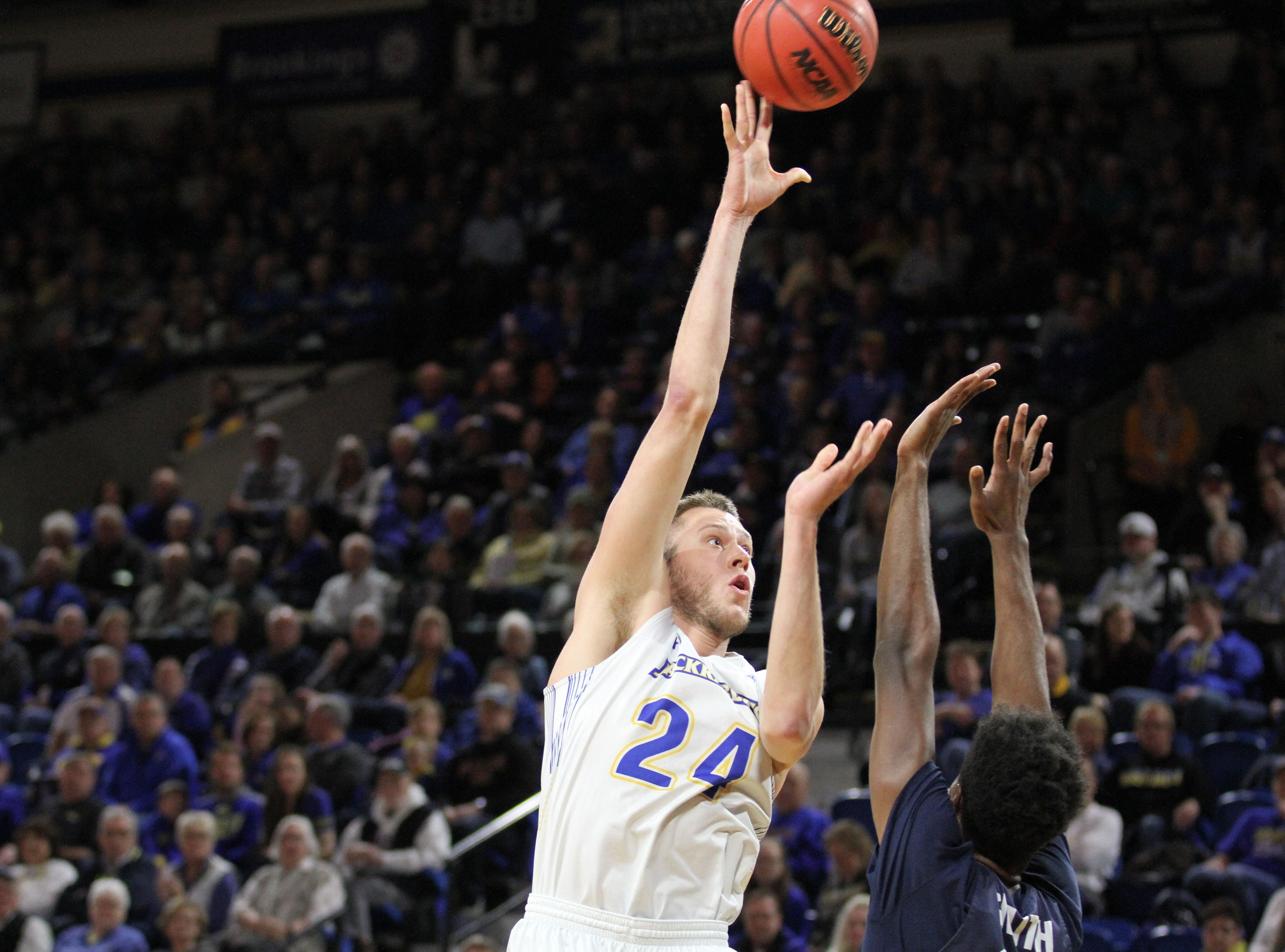 South Dakota State's Mike Daum (24) scores on a jumper over Oral Roberts' Kerwin Smith during the first half of the Jackrabbits' matchup with the Golden Eagles Saturday afternoon at Frost Arena in Brookings.