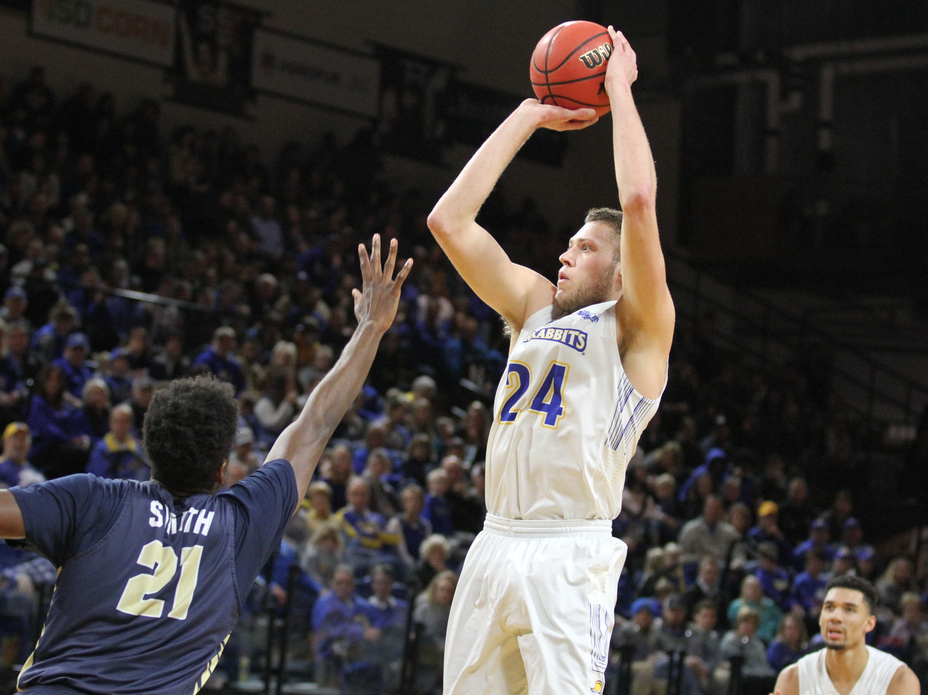 South Dakota State's Mike Daum (24) scores on a jumper in the paint over Oral Roberts' Kerwin Smith during the first half of the Jackrabbits' matchup with the Golden Eagles Saturday afternoon at Frost Arena in Brookings.