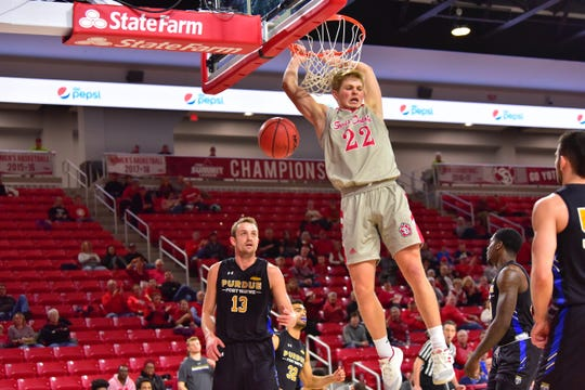 Tyler Peterson dunks over Purdue Fort Wayne on Sunday afternoon in the Coyotes' win over the Mastodons.