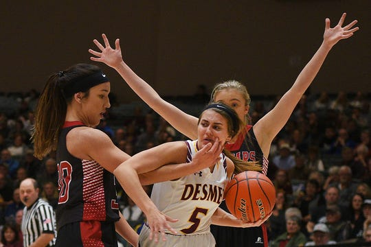 De Smet's Rynn Osthus goes against Corsica-Stickney defense in the Hanson Girls Classic Saturday, Jan. 12, at the Corn Palace in Mitchell.