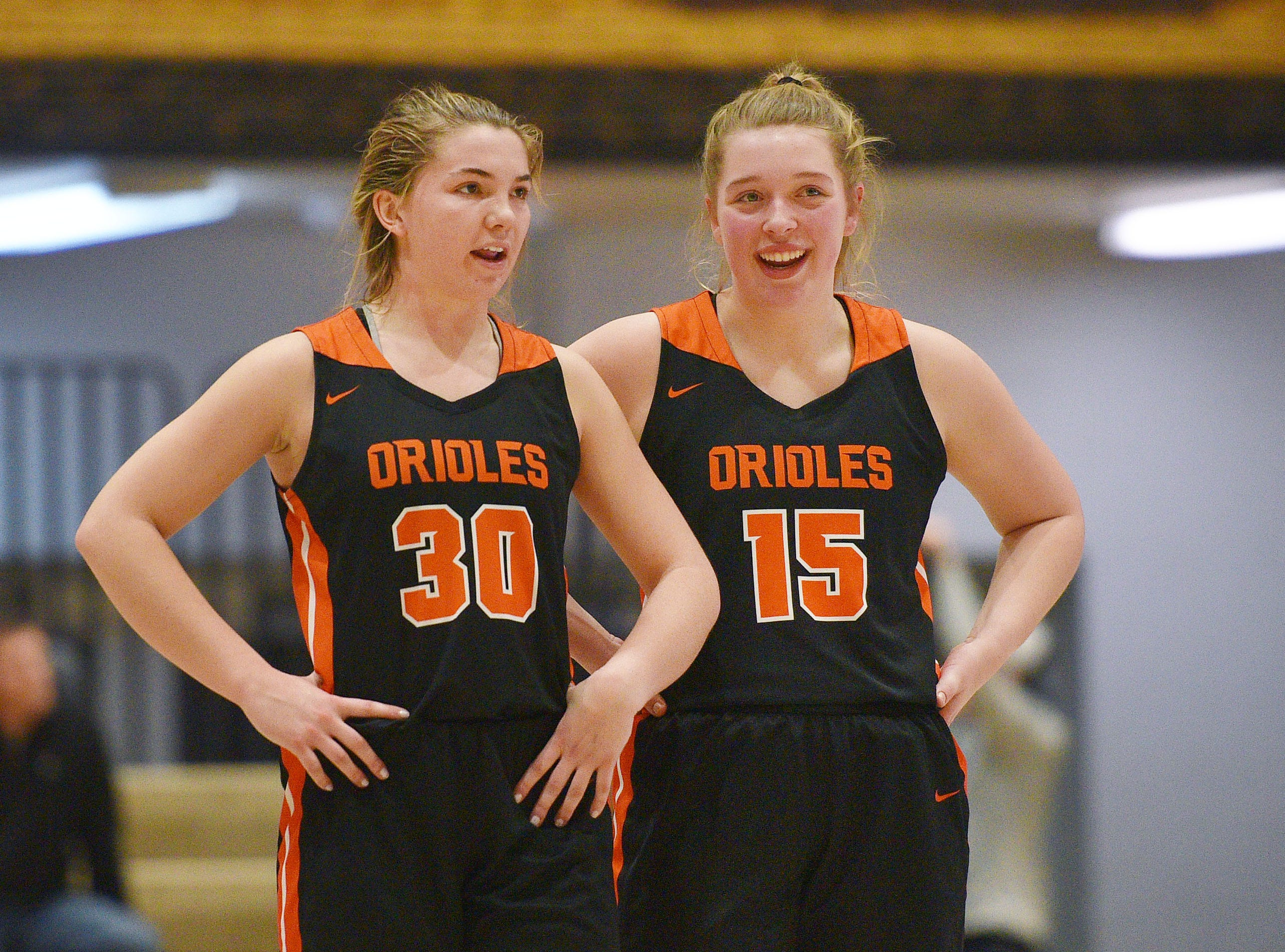 Lennox's Rianna Fillipi (30) and Mara Hinker (15) during the game against St. Thomas More in the Hanson Girls Classic Saturday,  Jan. 12, in Mitchell.