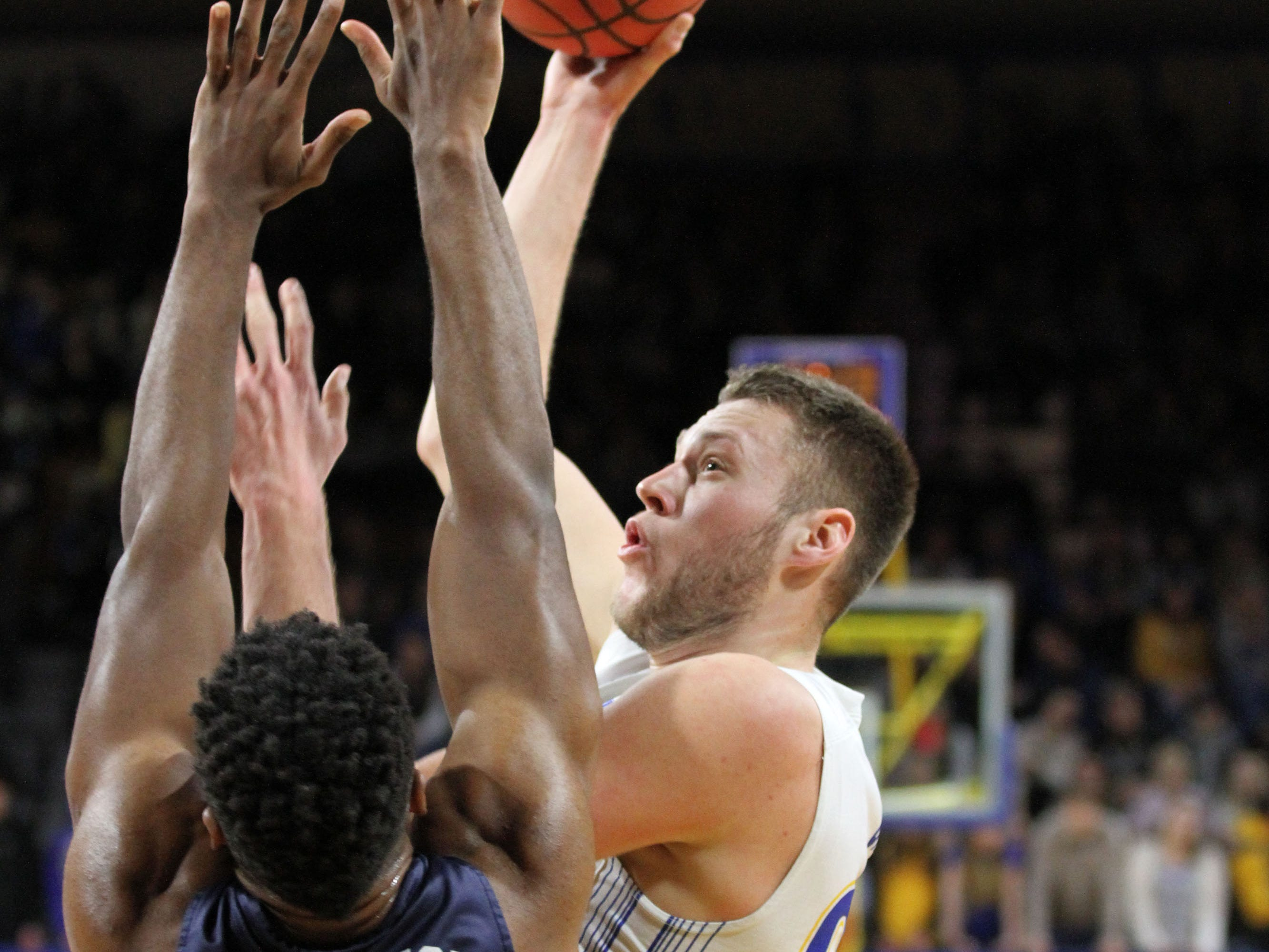 South Dakota State's Mike Daum (24) connects on a jumper in the paint over Oral Roberts' Emmanuel Nzekwesi during the first half of the Jackrabbits' matchup with the Golden Eagles Saturday afternoon at Frost Arena in Brookings.