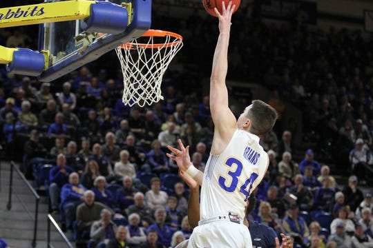 South Dakota State's Alex Arians (34) gets a bucket in the paint during the second half of the Jackrabbits' matchup with Oral Roberts Saturday afternoon at Frost Arena in Brookings.