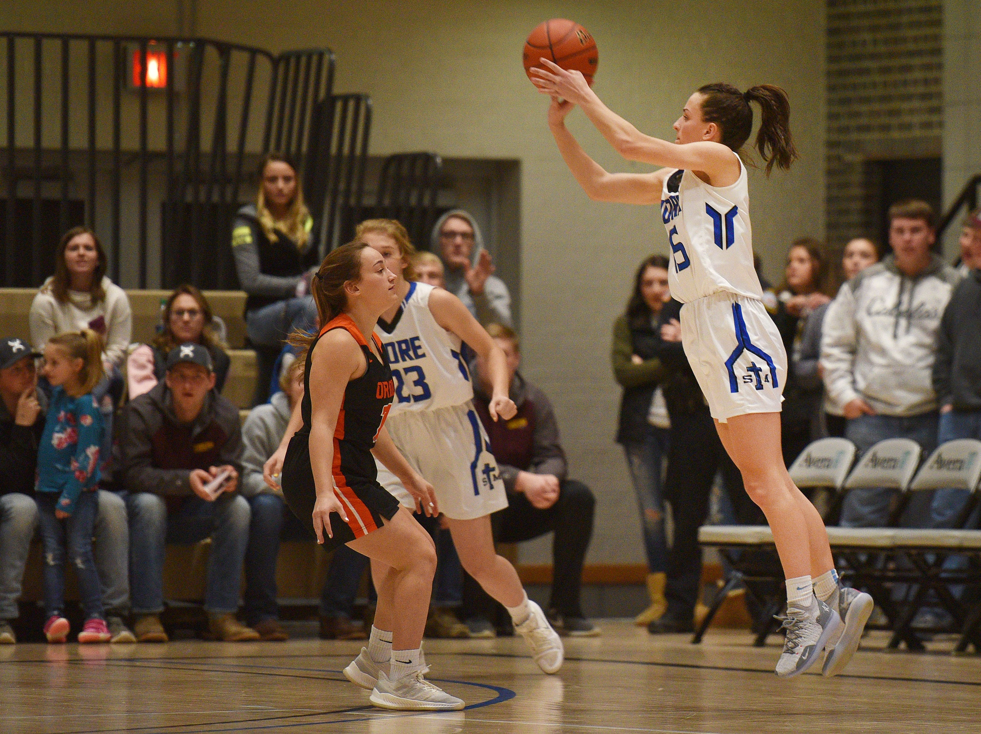 St. Thomas More's Ciara Benson attempts to score against Lennox in the Hanson Girls Classic Saturday,  Jan. 12, in Mitchell.
