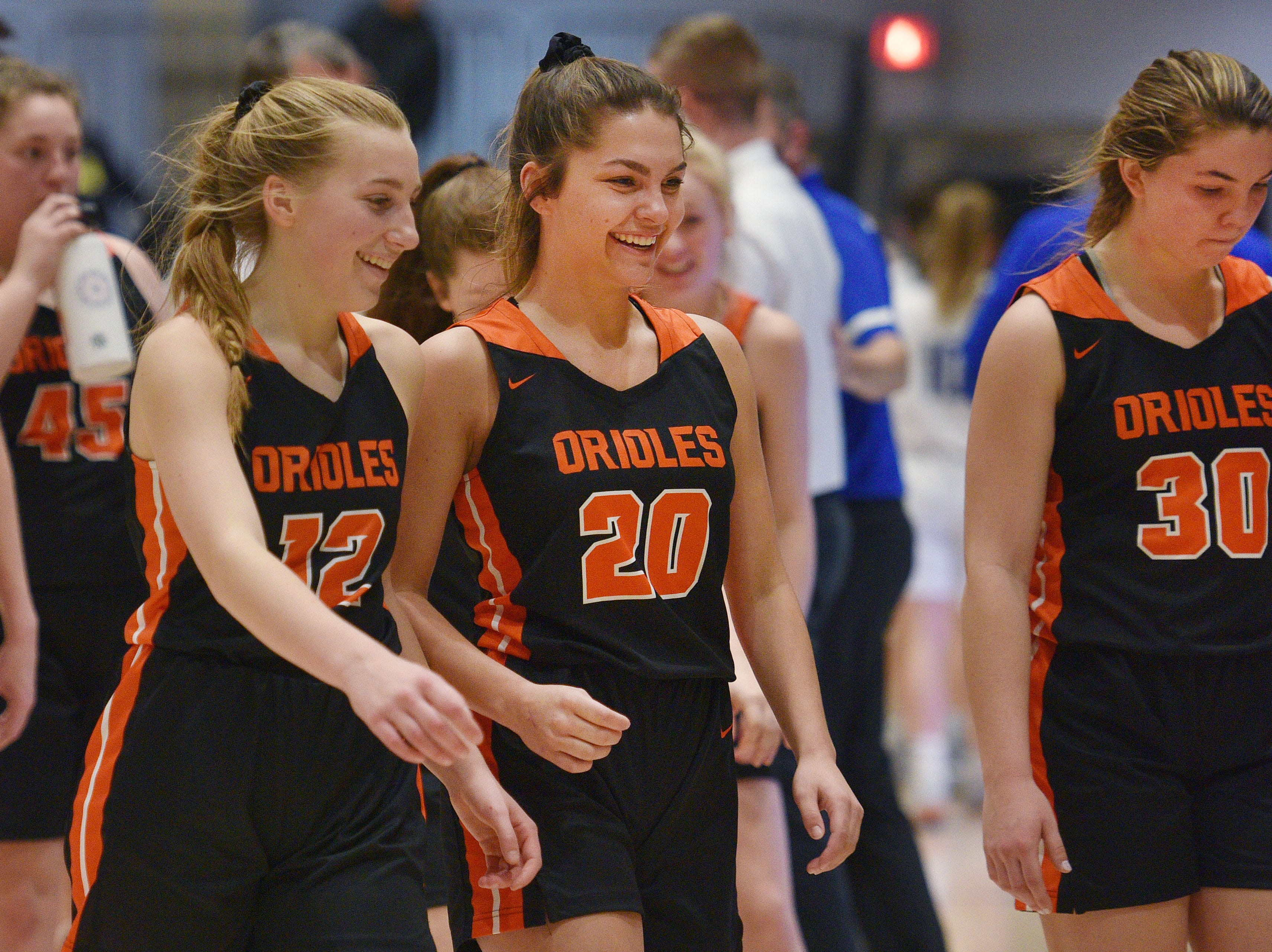 Lennox's Isabel Ihnen (12), Jenaka DeCou (20) and Rianna Fillipi (30) walk off the court after their win against St. Thomas More in the Hanson Girls Classic Saturday,  Jan. 12, in Mitchell.