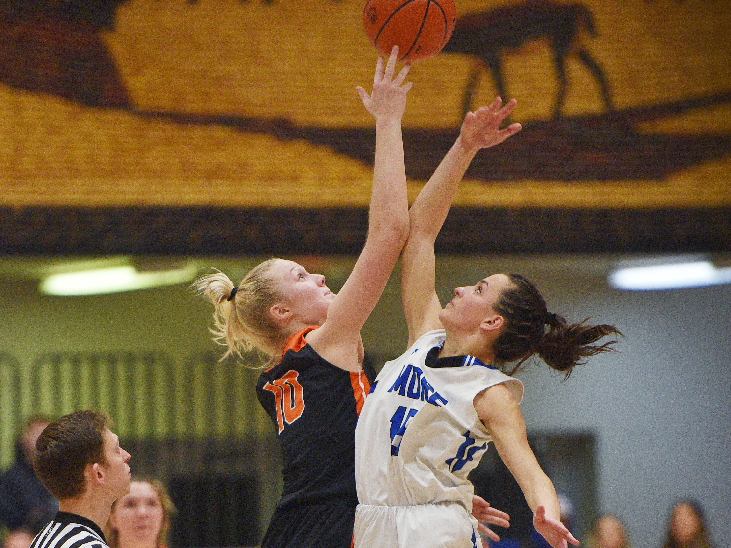 Lennox's Madysen Vlastuin and St. Thomas More's Ciara Benson tip-off for overtime in the Hanson Girls Classic Saturday,  Jan. 12, in Mitchell.