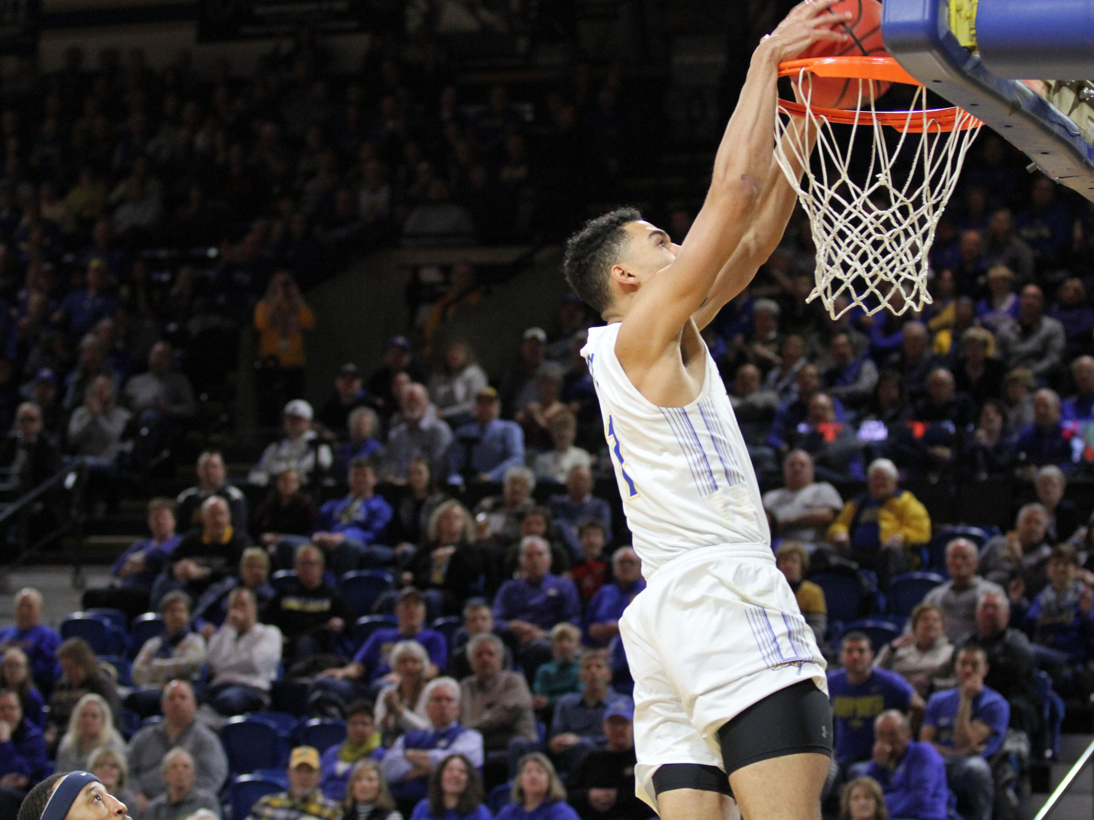 South Dakota State's Skylar Flatten gets a dunk on a fast break during the first half of the Jackrabbit's matchup with Oral Roberts Saturday afternoon at Frost Arena in Brookings.