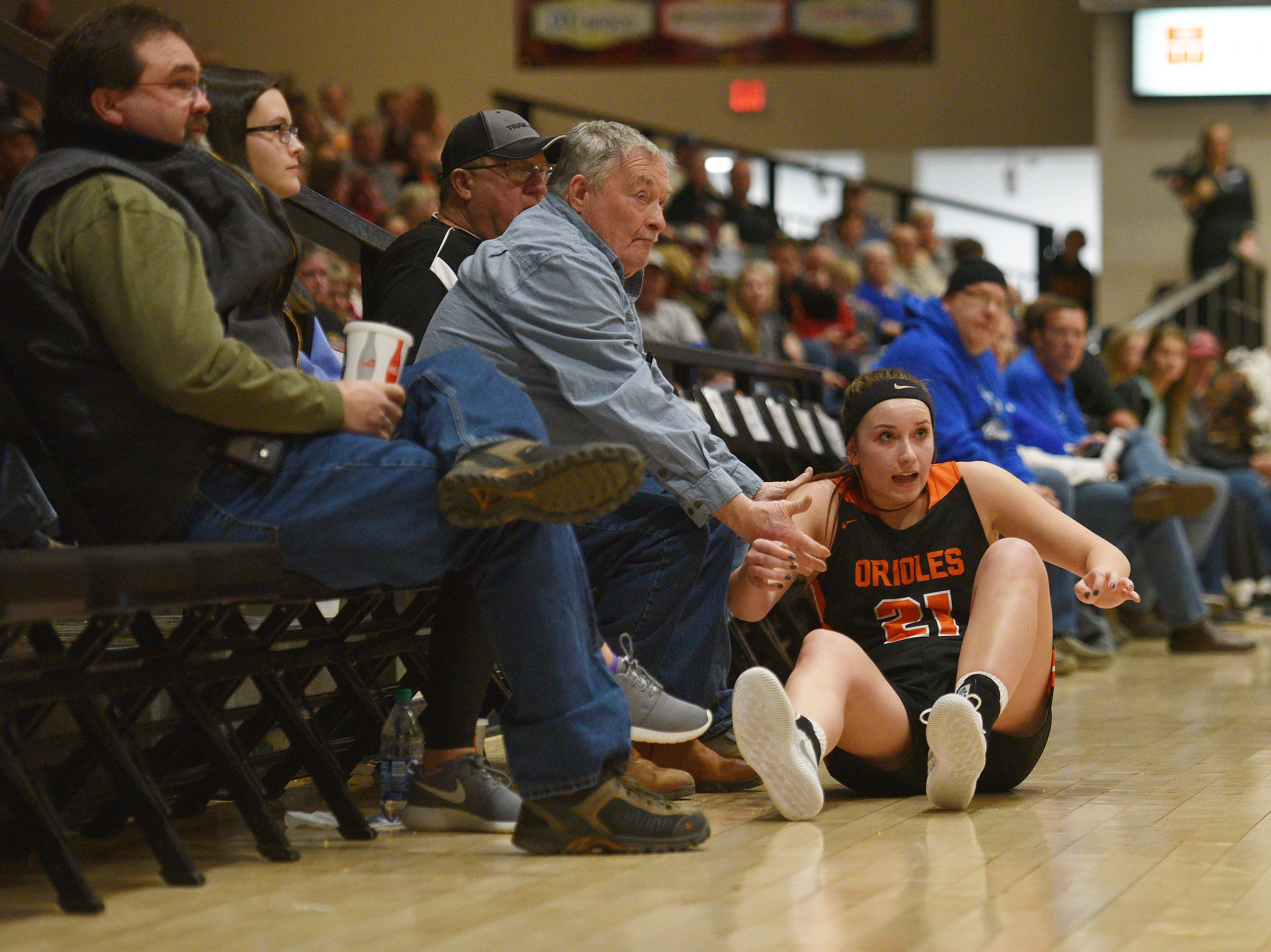Lennox's Riley Peters falls into the court side seats during the game against St. Thomas More in the Hanson Girls Classic Saturday,  Jan. 12, in Mitchell.