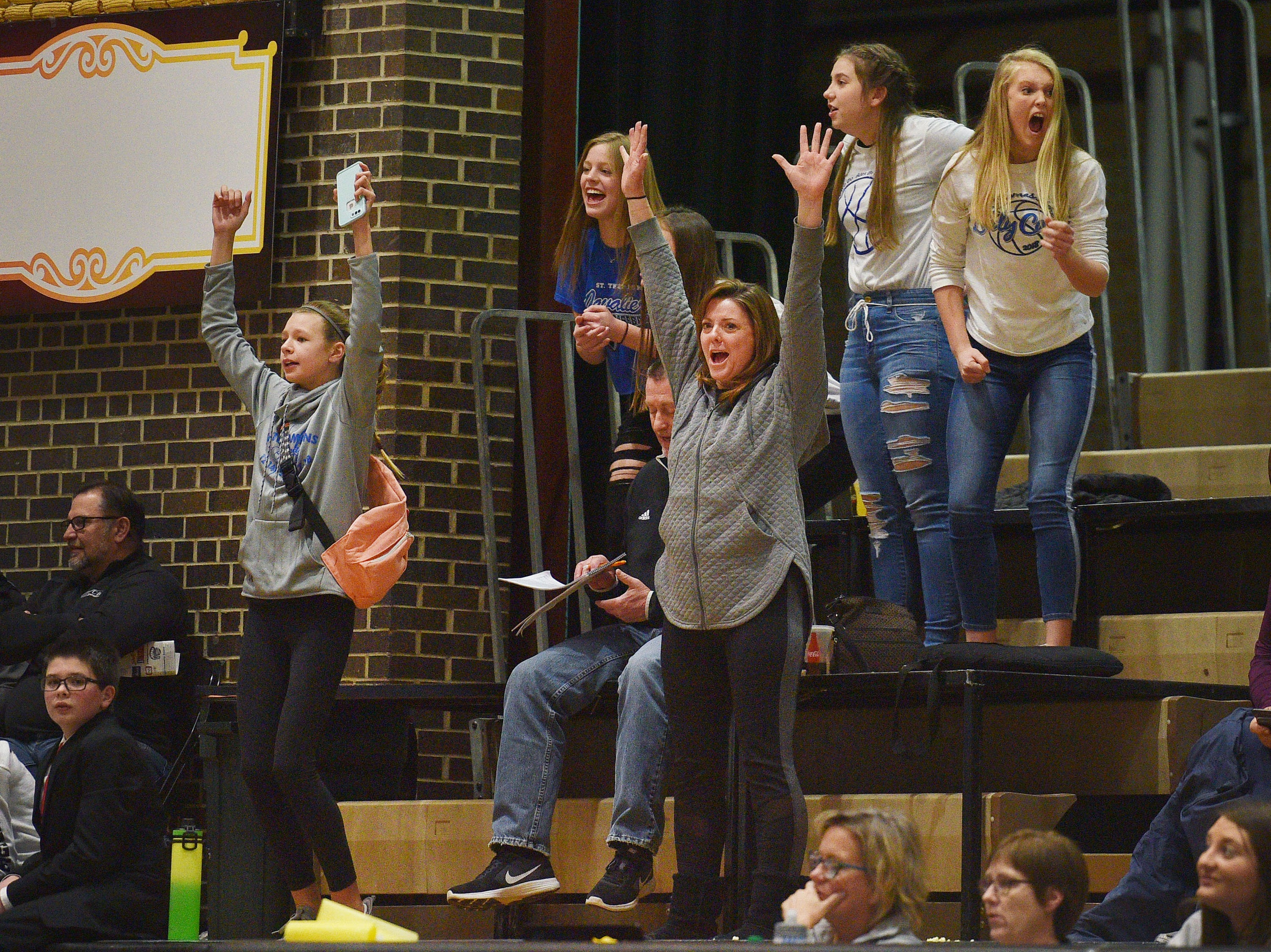 St. Thomas More fans cheer during the game against Lennox in the Hanson Girls Classic Saturday,  Jan. 12, in Mitchell.