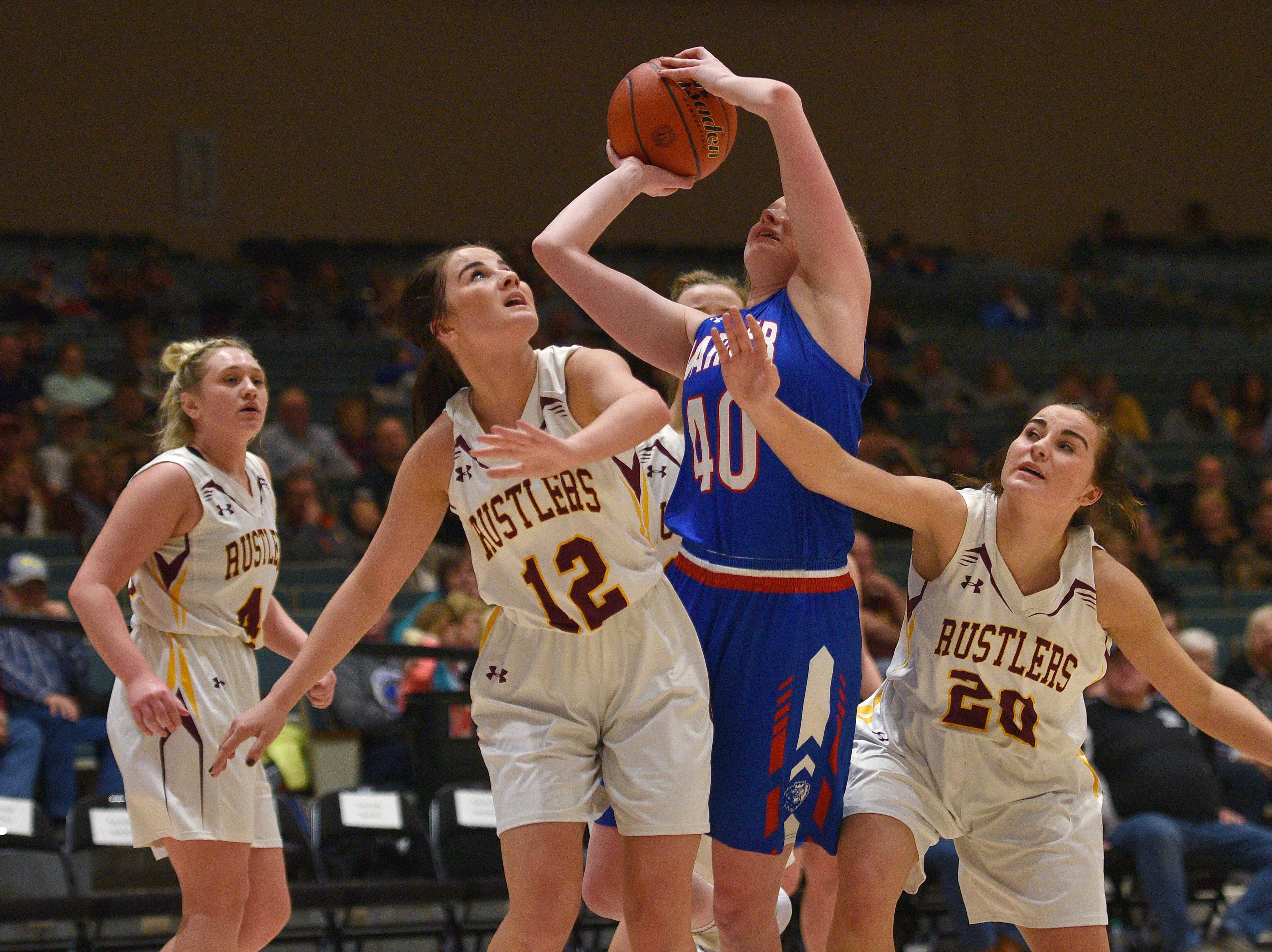 Warner's Laurie Rogers goes against Ethan's Maddie Miiller (12) and Mollie Miiller (20) in the Hanson Girls Classic Saturday,  Jan. 12, in Mitchell.
