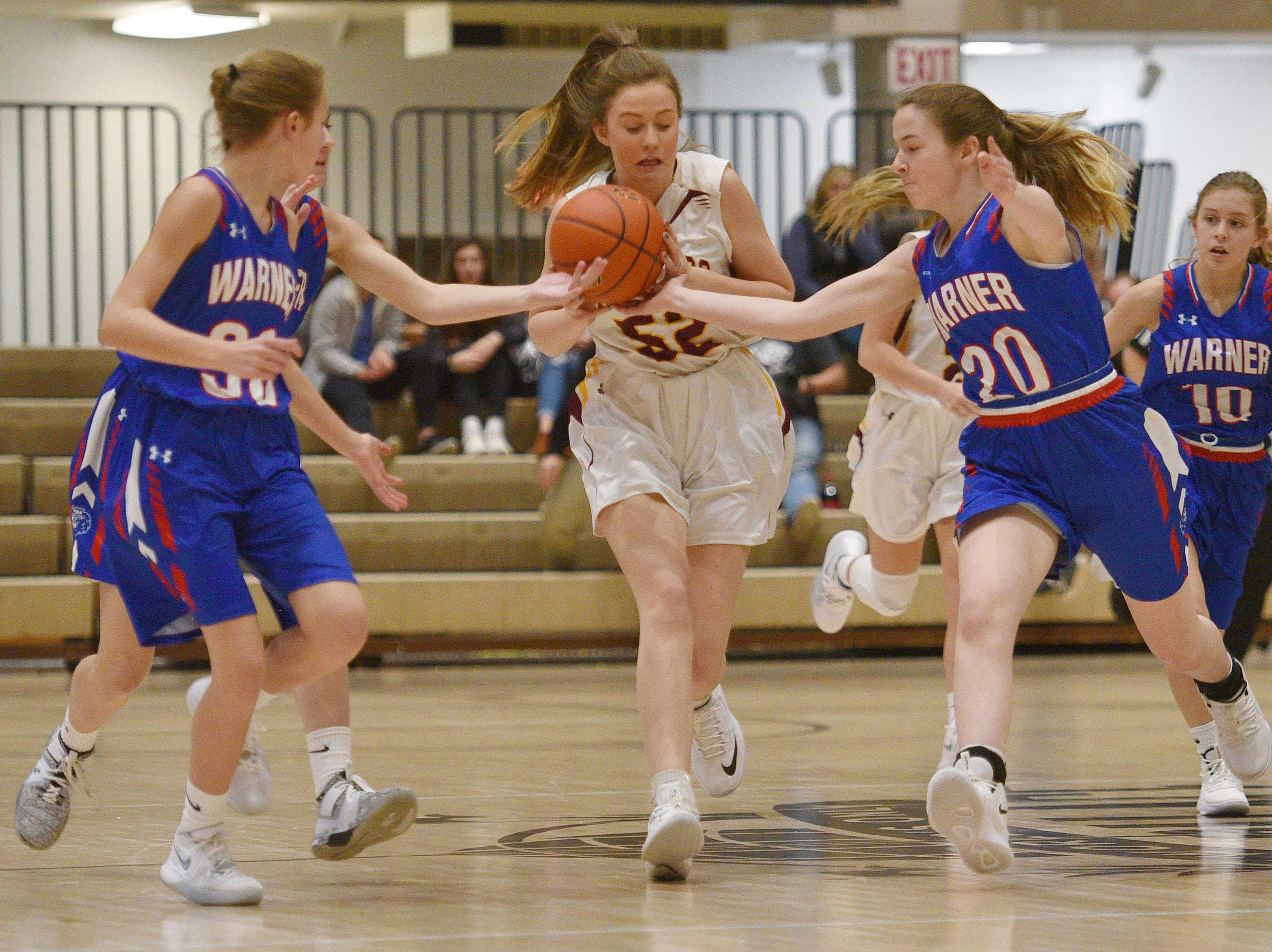 Ethan's Gabby Sonne goes against Warner defense in the Hanson Girls Classic Saturday,  Jan. 12, in Mitchell.