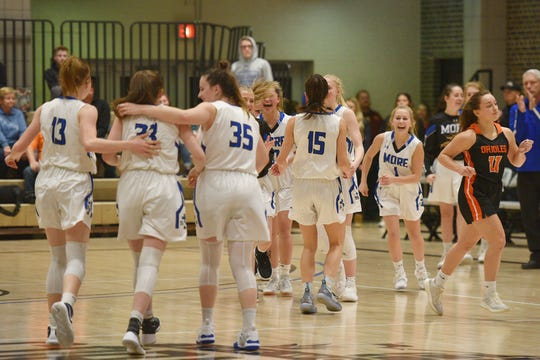 St. Thomas More celebrates as they go into overtime against Lennox in the Hanson Girls Classic Saturday,  Jan. 12, in Mitchell.