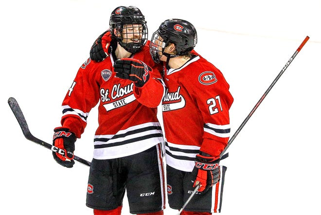 Patrick Newell (14) and Blake Lizotte celebrate a late third-period goal Jan. 12 in Duluth. Newell is the Huskies' leading scorer. SCSU plays at 7:37 p.m. Friday and 7:07 p.m. Saturday at the University of North Dakota in Grand Forks.
