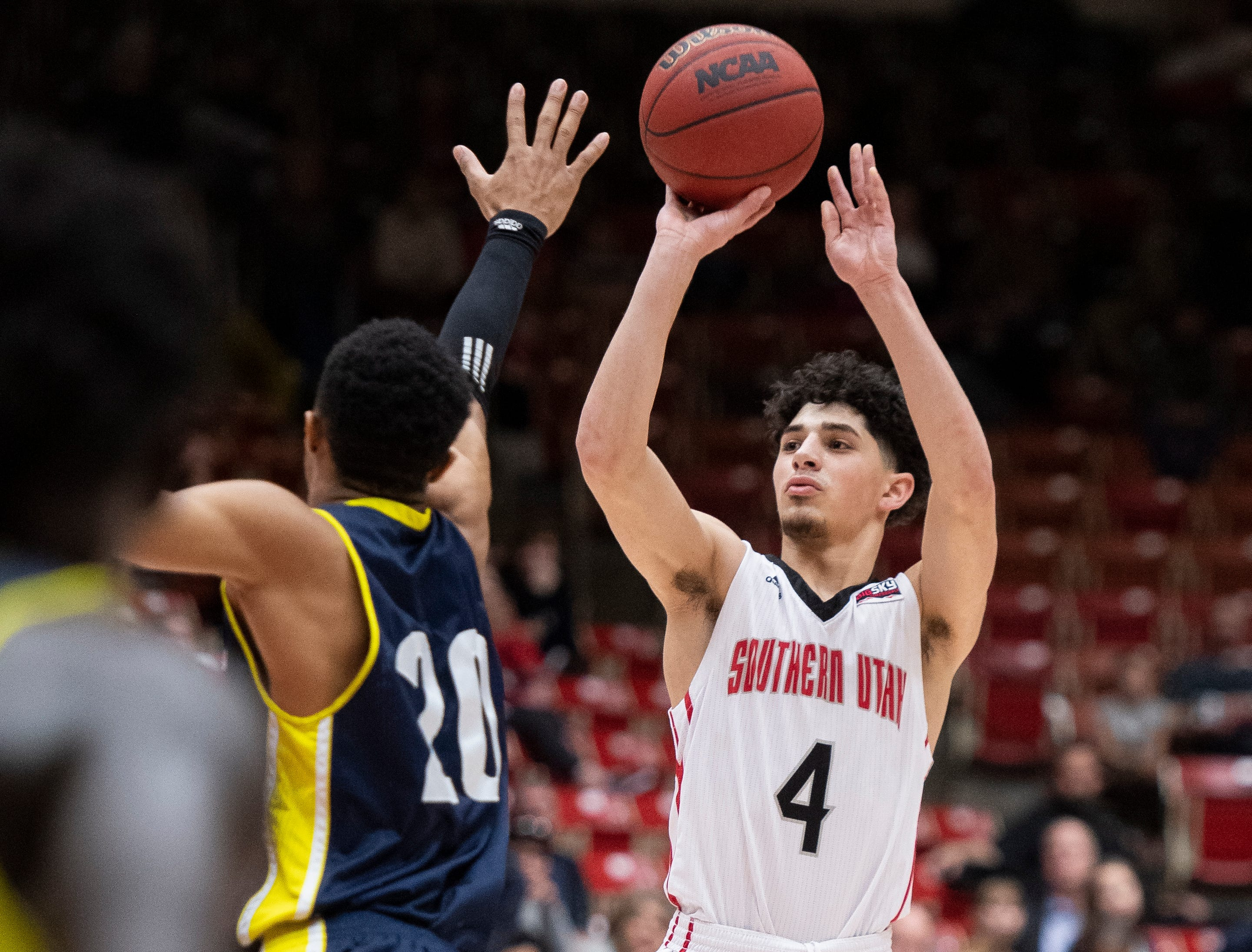 Southern Utah University sophomore Dre Marin (4) makes a three-point basket for the lead against rival Northern Arizona at the America First Event Center Saturday, January 12, 2019. SUU won, 84-82.