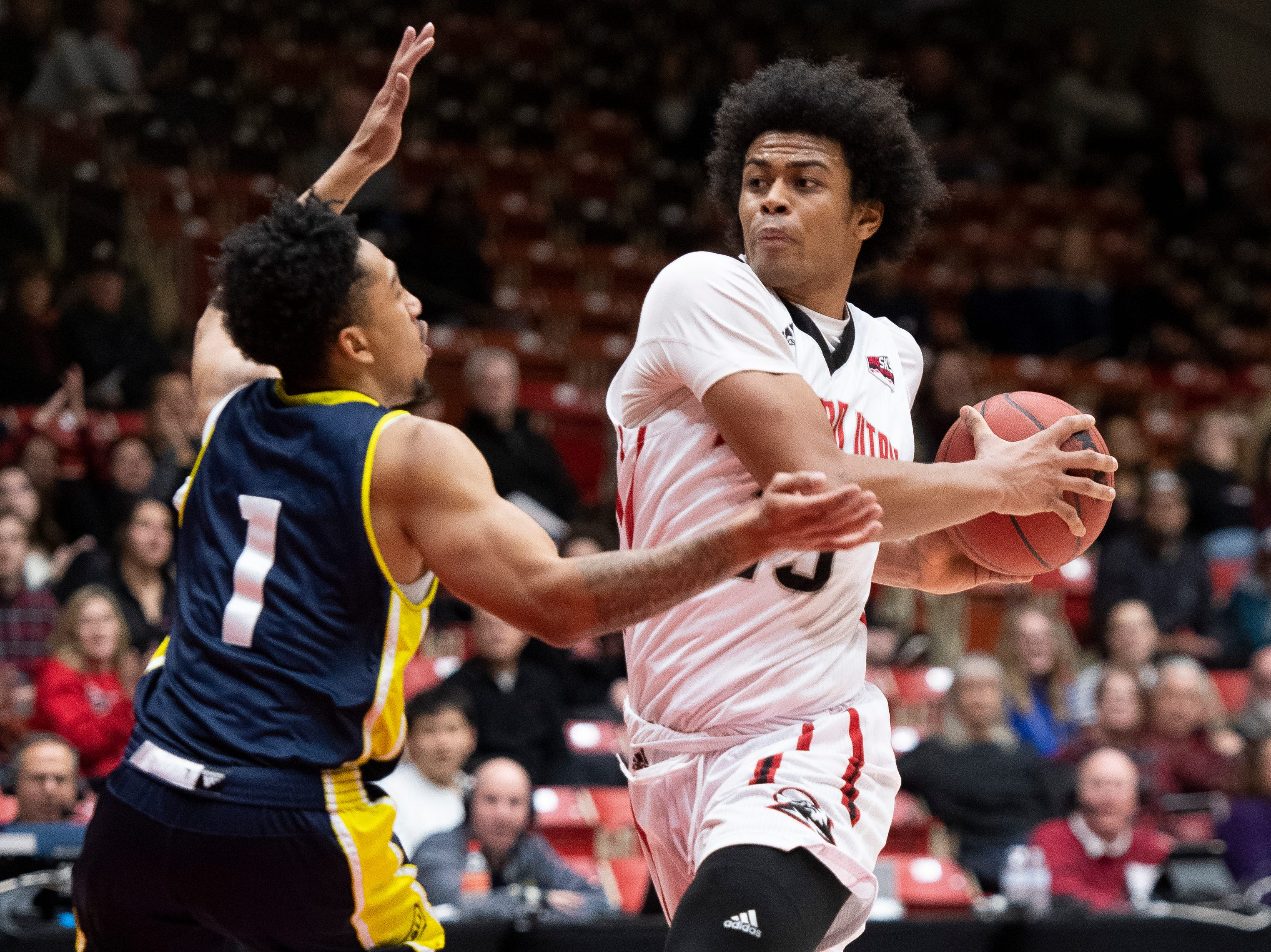 Southern Utah University freshman Harrison Butler (15) moves the ball against rival Northern Arizona at the America First Event Center Saturday, January 12, 2019. SUU won, 84-82.