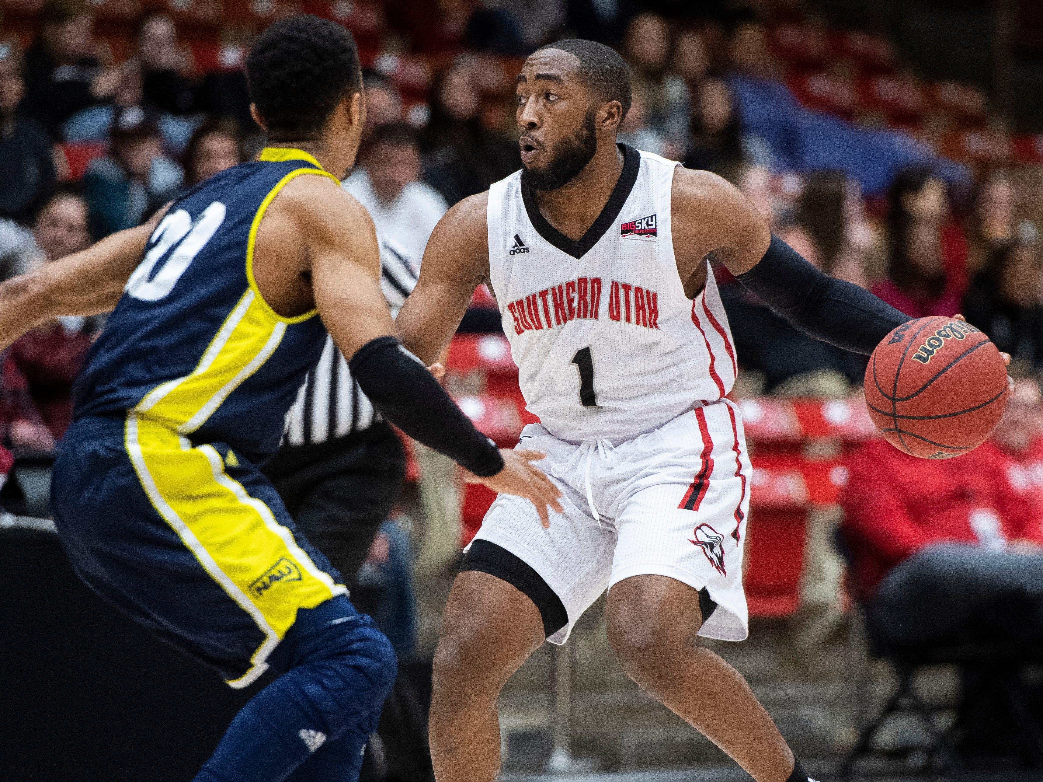 Southern Utah University freshman Kenton Eskridge (1) looks for options against rival Northern Arizona at the America First Event Center Saturday, January 12, 2019. SUU won, 84-82.