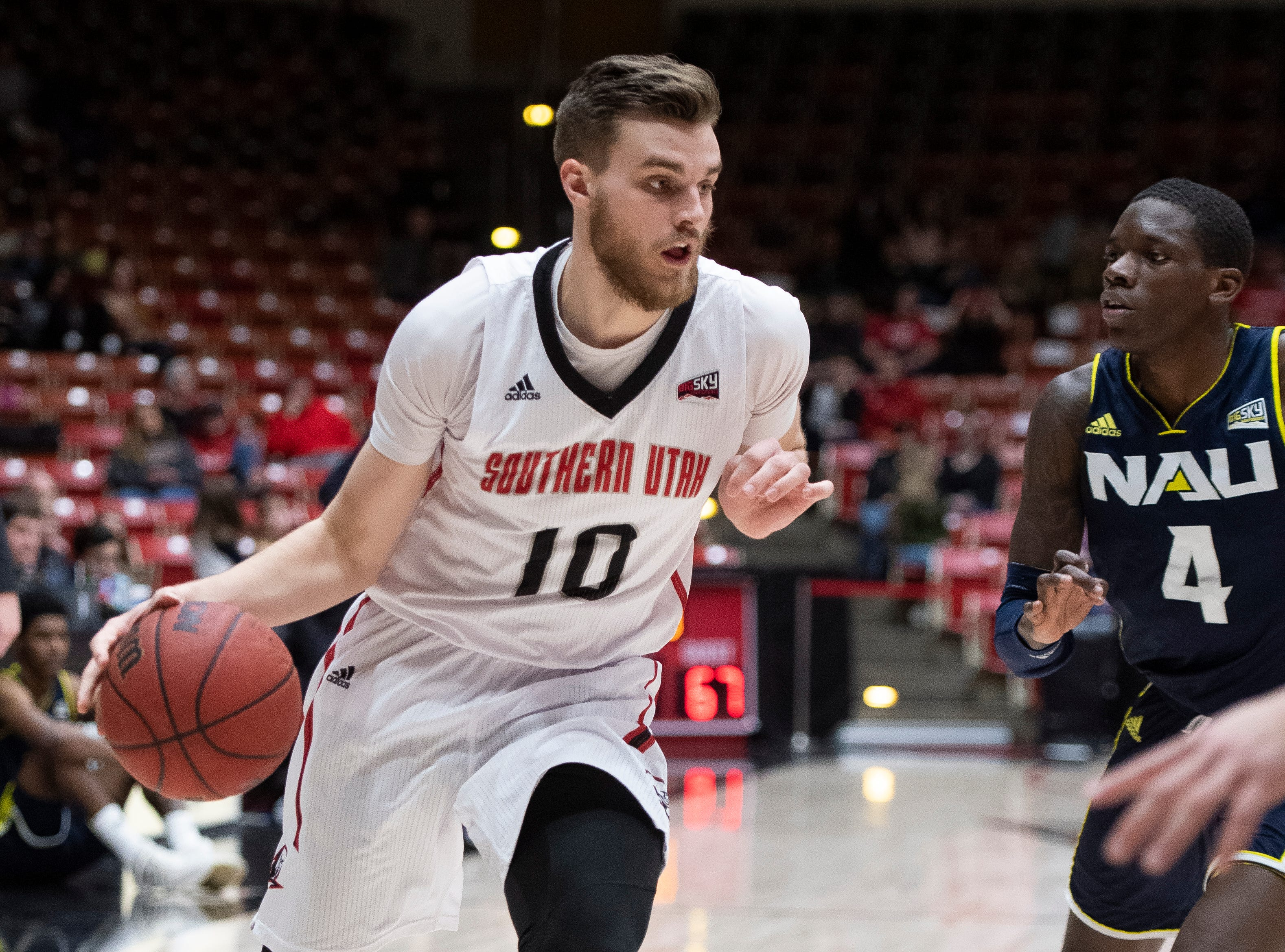 Southern Utah University junior Jacob Calloway (10) moves the ball against rival Northern Arizona at the America First Event Center Saturday, January 12, 2019. SUU won, 84-82.