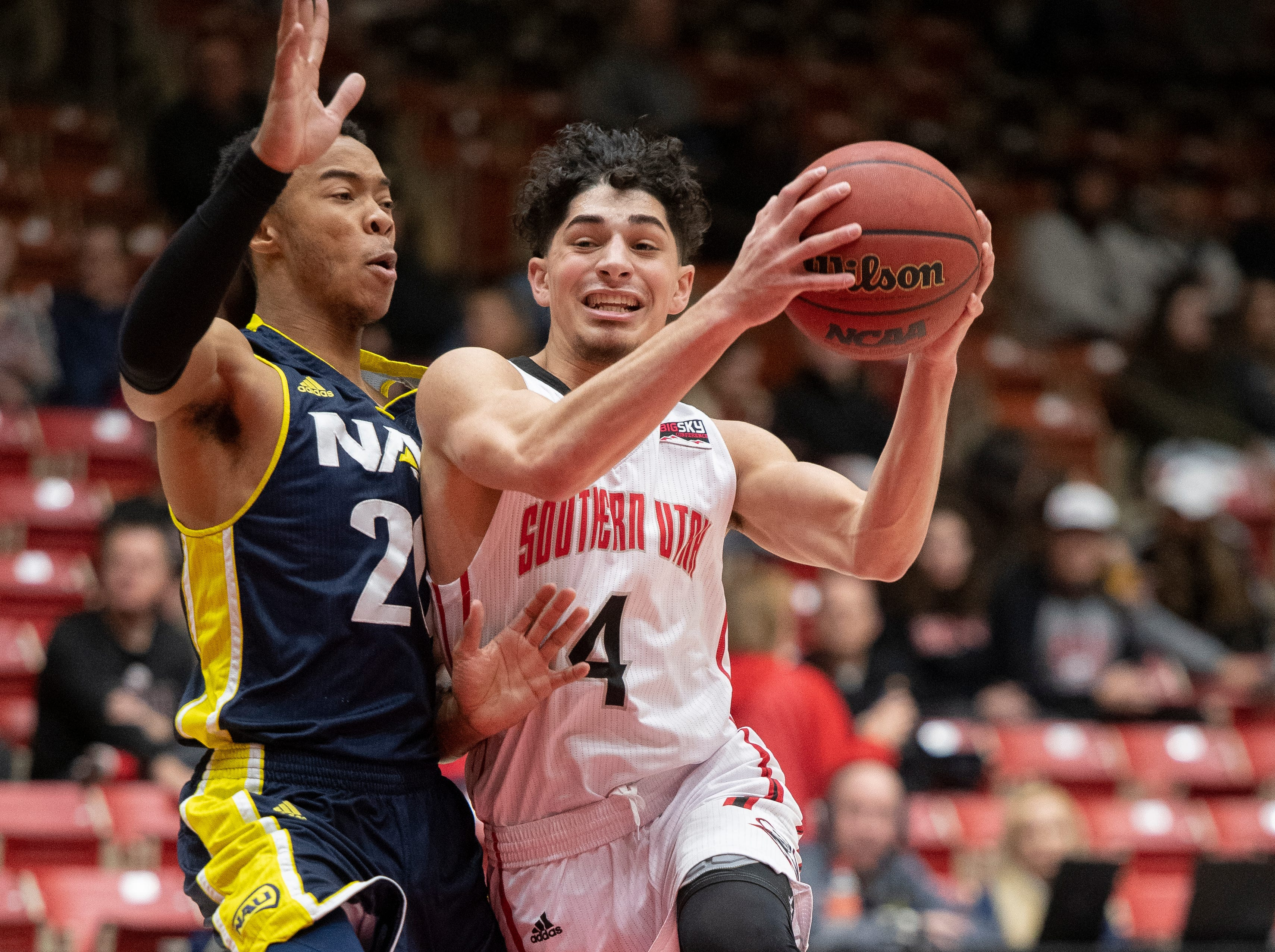 Southern Utah University sophomore Dre Marin (4) moves the ball against rival Northern Arizona at the America First Event Center Saturday, January 12, 2019. SUU won, 84-82.