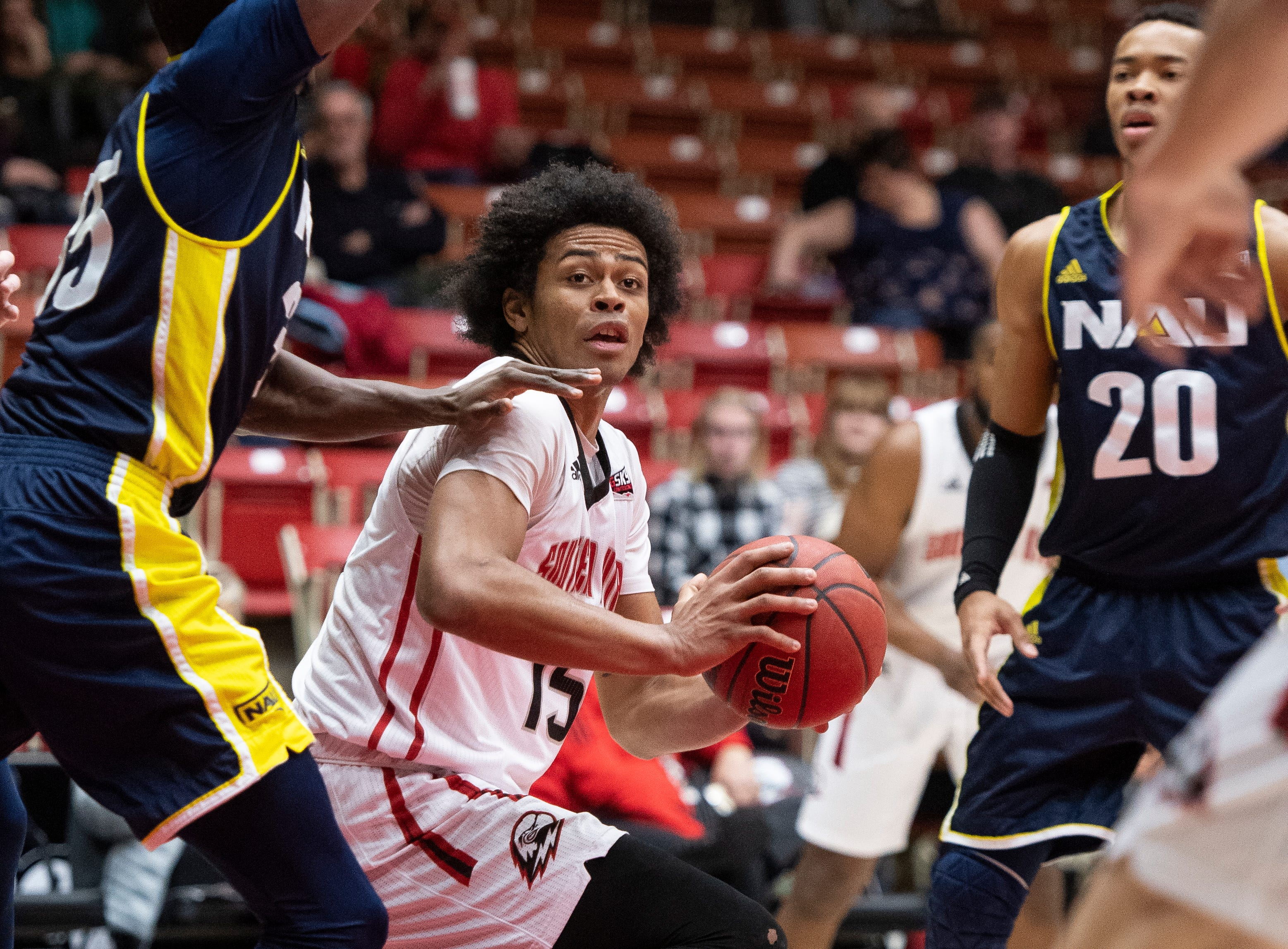 Southern Utah University freshman Harrison Butler (15) looks for space in the key against rival Northern Arizona at the America First Event Center Saturday, January 12, 2019. SUU won, 84-82.