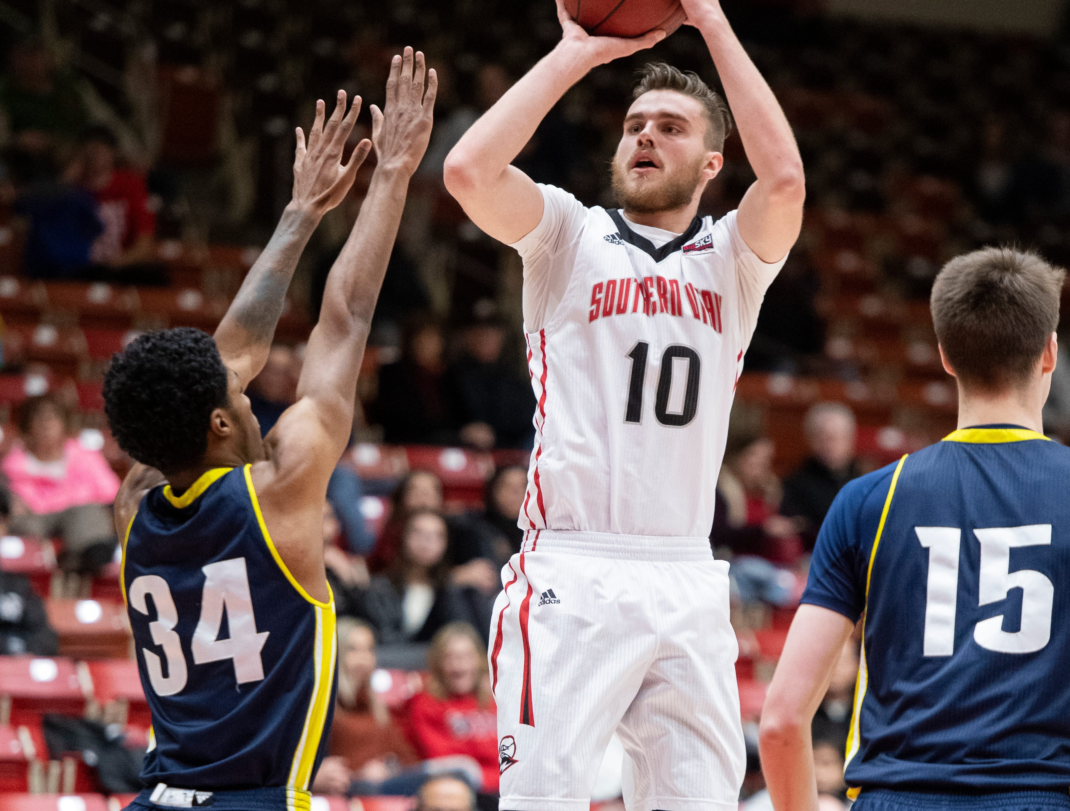 Southern Utah University junior Jacob Calloway (10) sinks a three-point basket against rival Northern Arizona at the America First Event Center Saturday, January 12, 2019. SUU won, 84-82.
