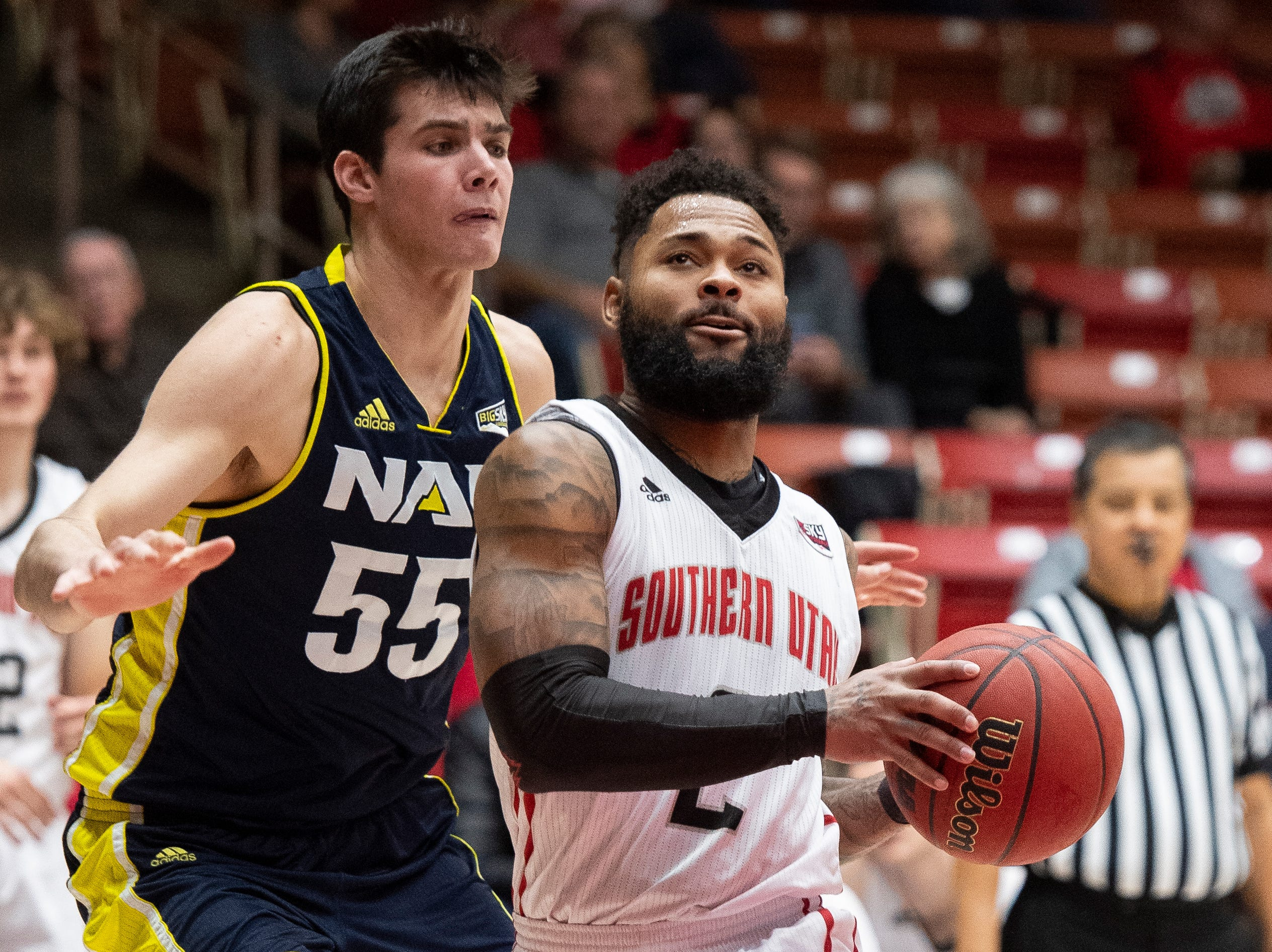 Southern Utah University senior Brandon Better (2) moves to the basket against rival Northern Arizona at the America First Event Center Saturday, January 12, 2019. SUU won, 84-82.