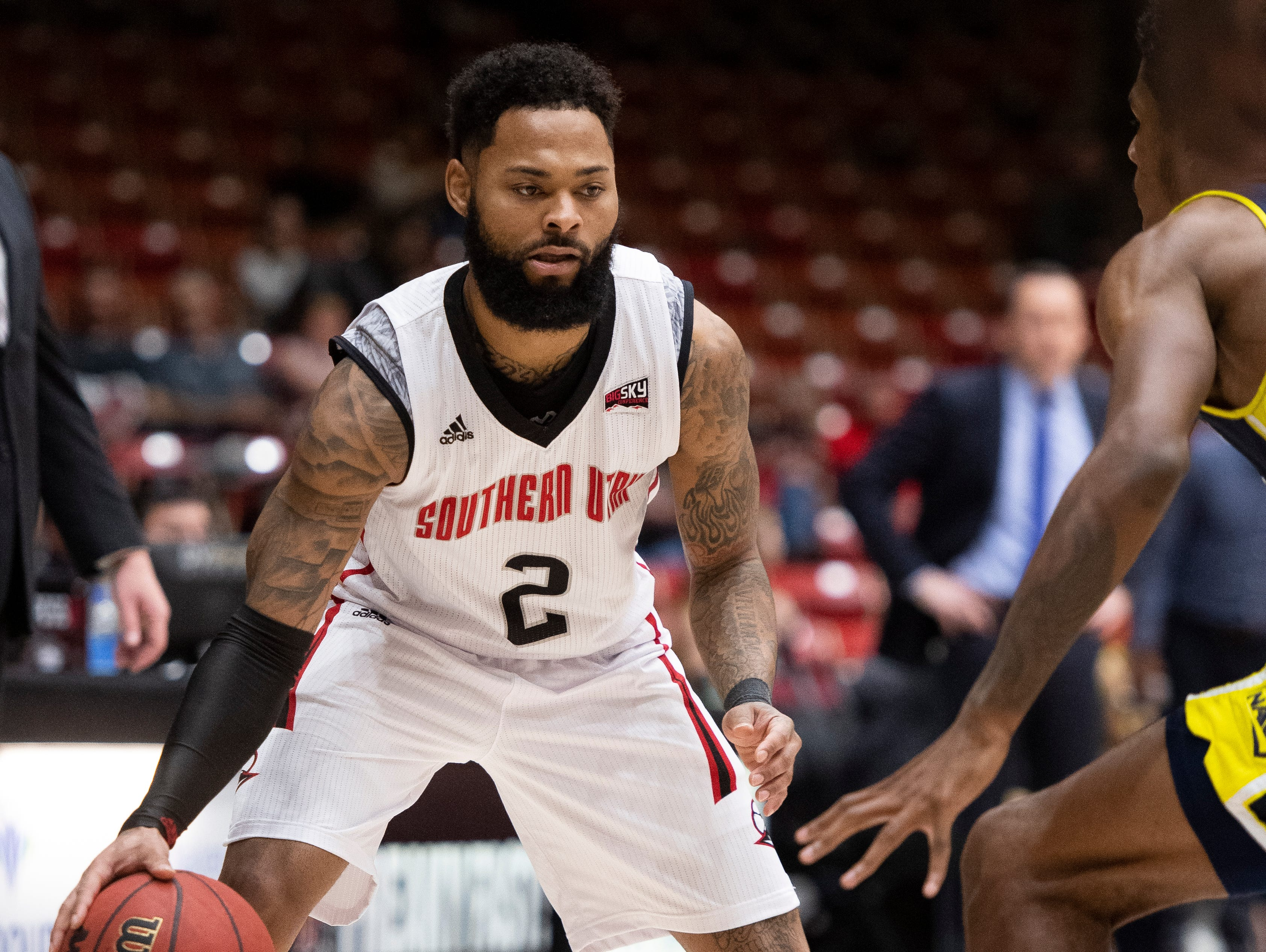 Southern Utah University senior Brandon Better (2) moves the ball against rival Northern Arizona at the America First Event Center Saturday, January 12, 2019. SUU won, 84-82.