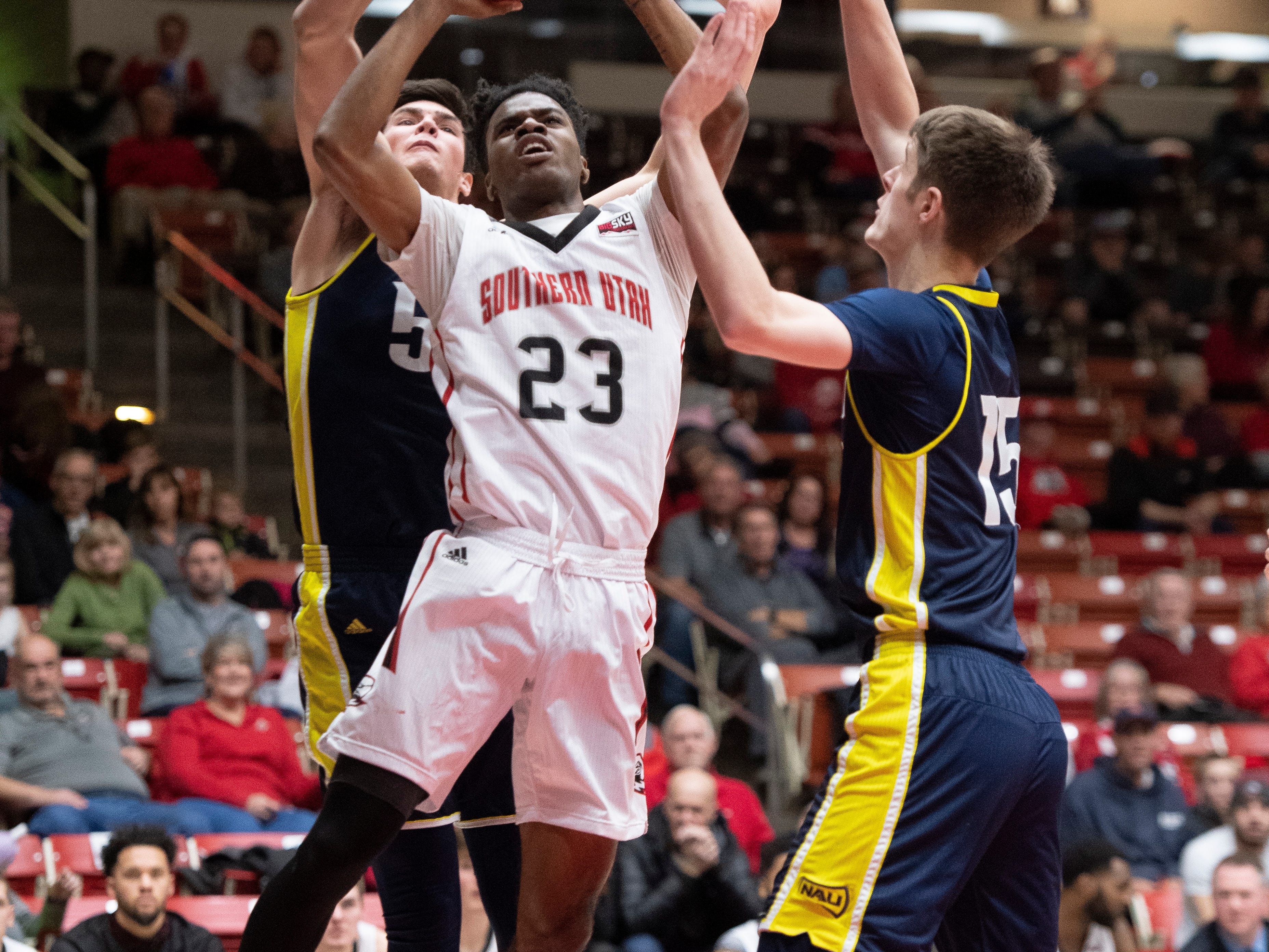 Southern Utah University junior Cameron Oluyitan (23) takes a shot against rival Northern Arizona at the America First Event Center Saturday, January 12, 2019. SUU won, 84-82.