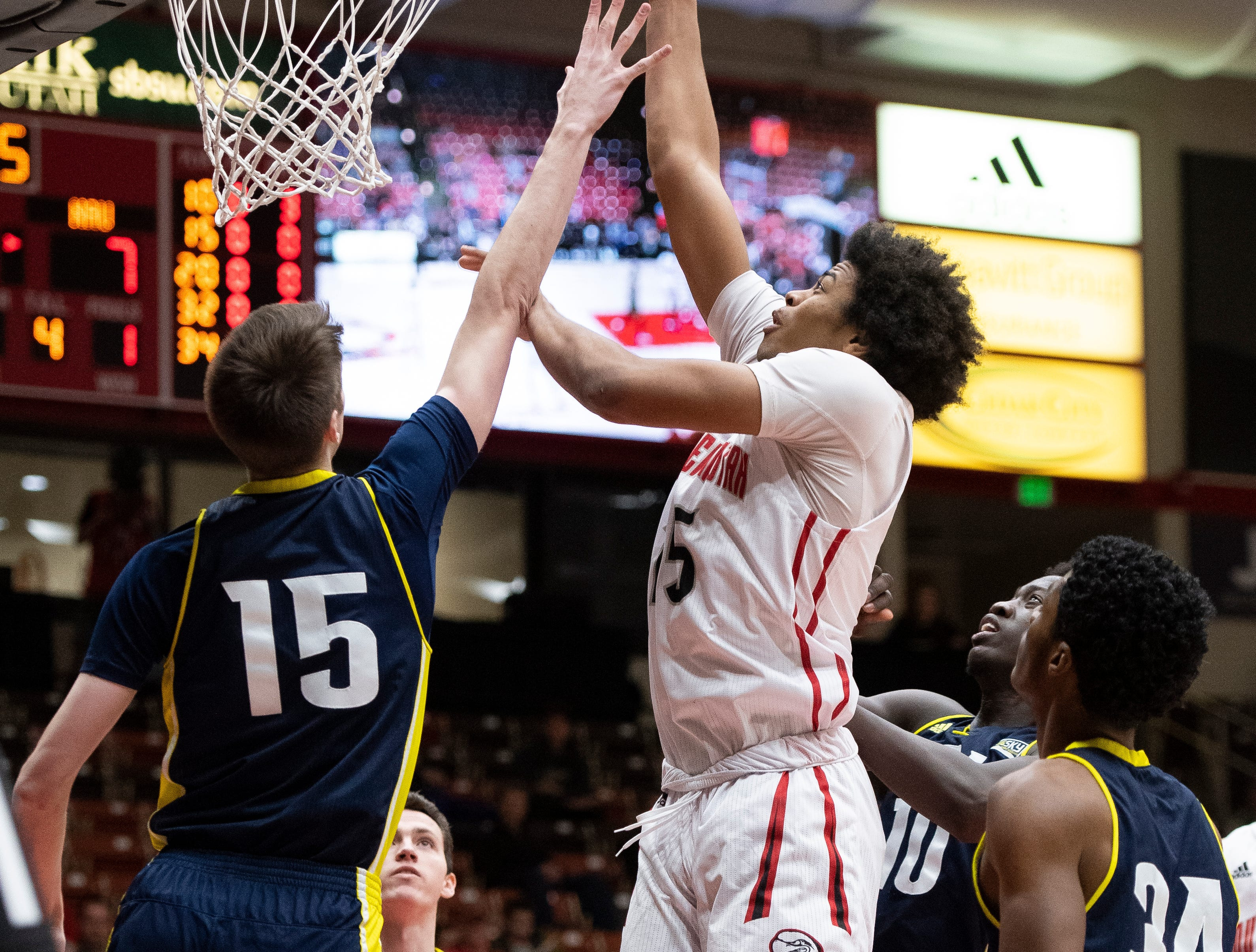 Southern Utah University freshman Harrison Butler (15) scores against rival Northern Arizona at the America First Event Center Saturday, January 12, 2019. SUU won, 84-82.