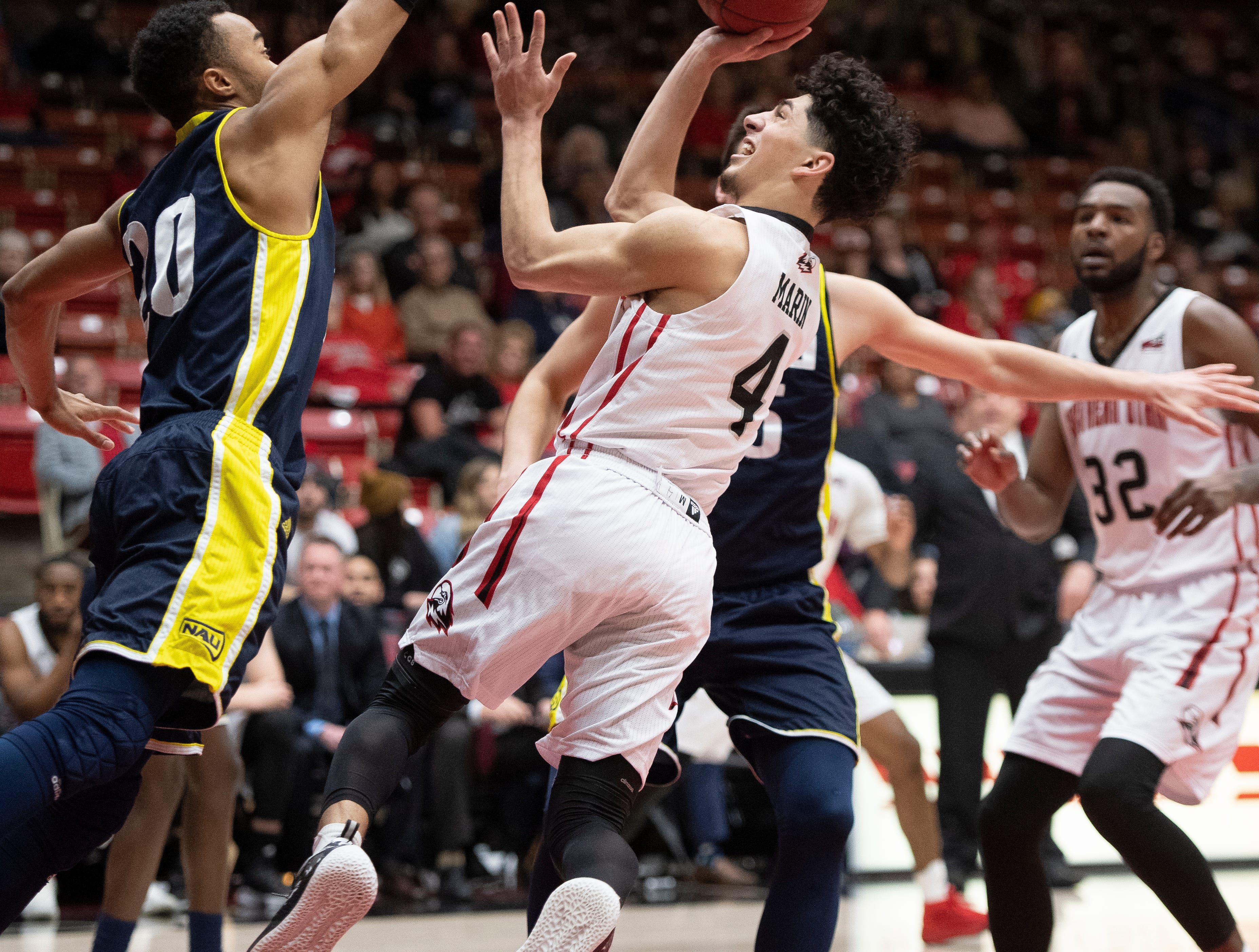 Southern Utah University sophomore Dre Marin (4) gets up close against rival Northern Arizona at the America First Event Center Saturday, January 12, 2019. SUU won, 84-82.