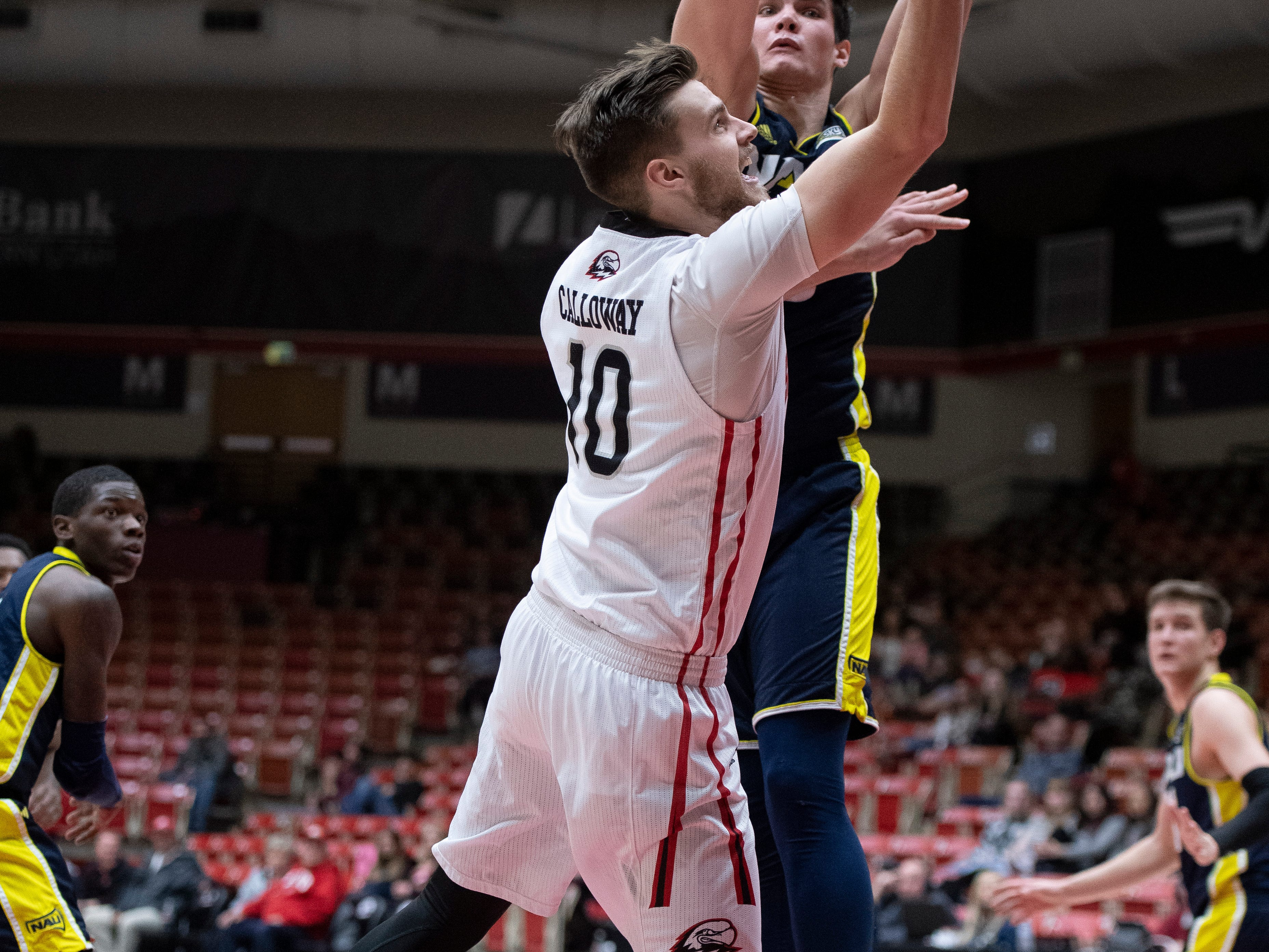 Southern Utah University junior Jacob Calloway (10) takes a shot against rival Northern Arizona at the America First Event Center Saturday, January 12, 2019. SUU won, 84-82.
