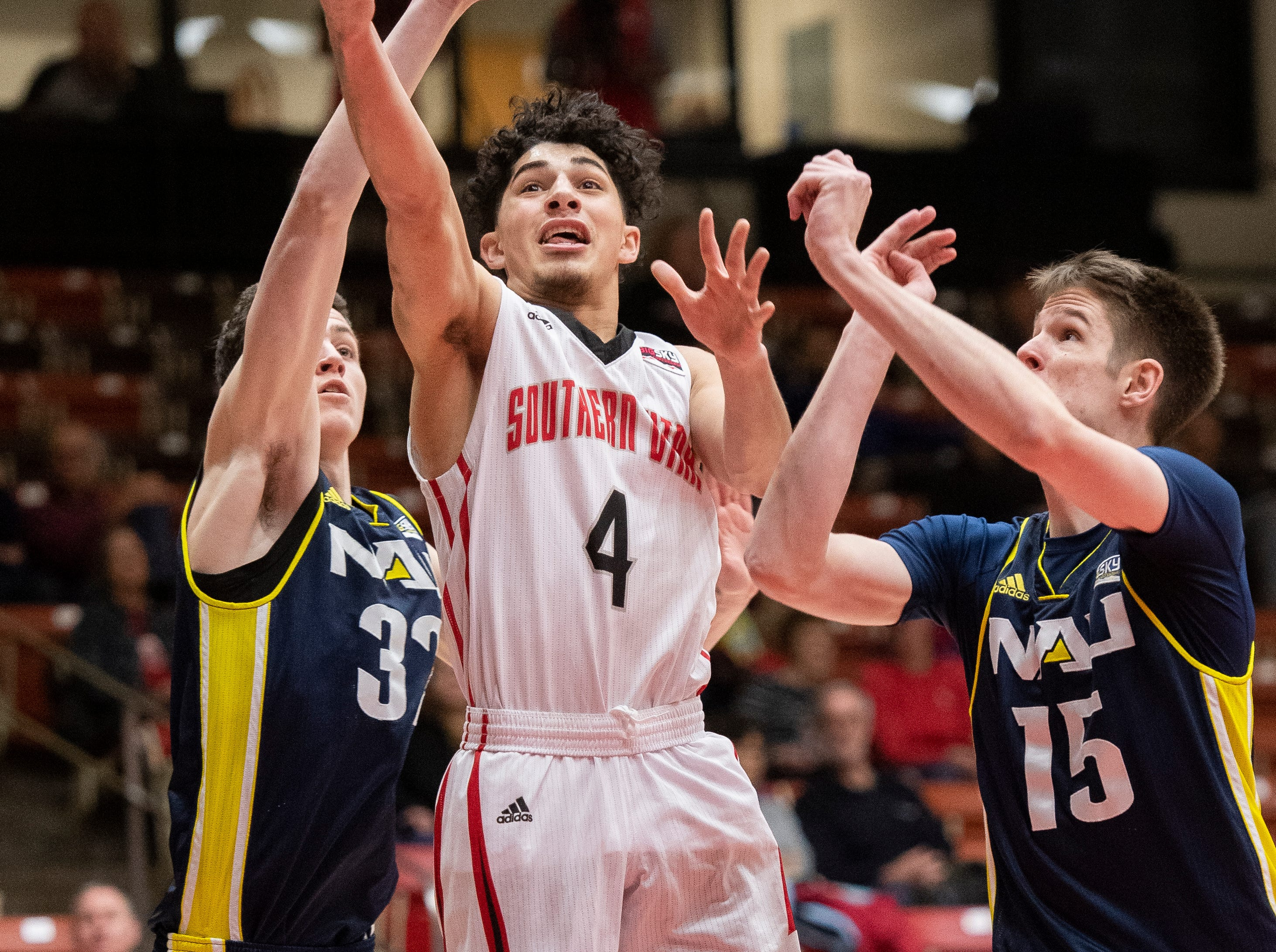 Southern Utah University sophomore Dre Marin (4) takes a shot against rival Northern Arizona at the America First Event Center Saturday, January 12, 2019. SUU won, 84-82.