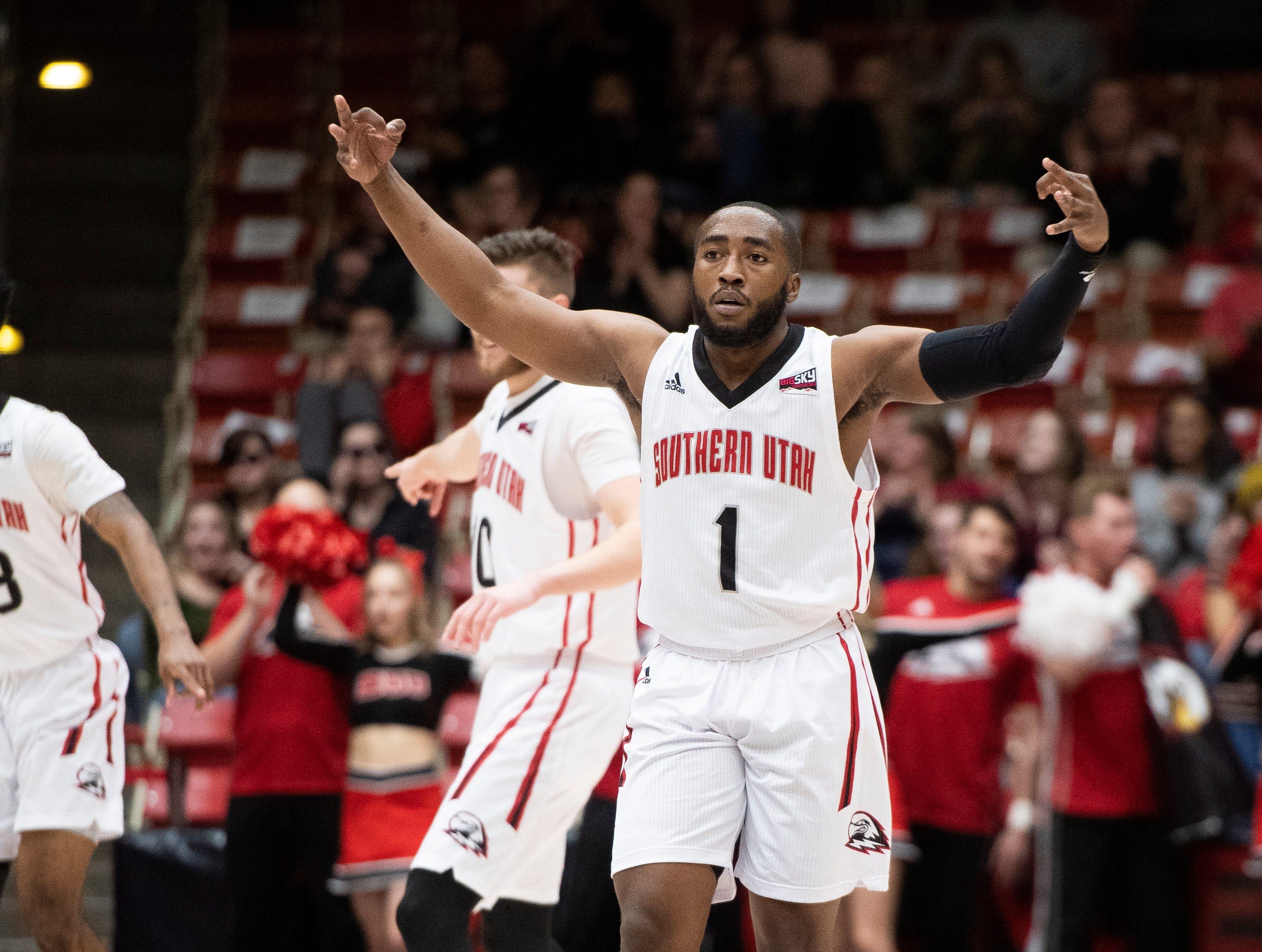 Southern Utah University freshman Kenton Eskridge (1) celebrates a basket against rival Northern Arizona at the America First Event Center Saturday, January 12, 2019. SUU won, 84-82.