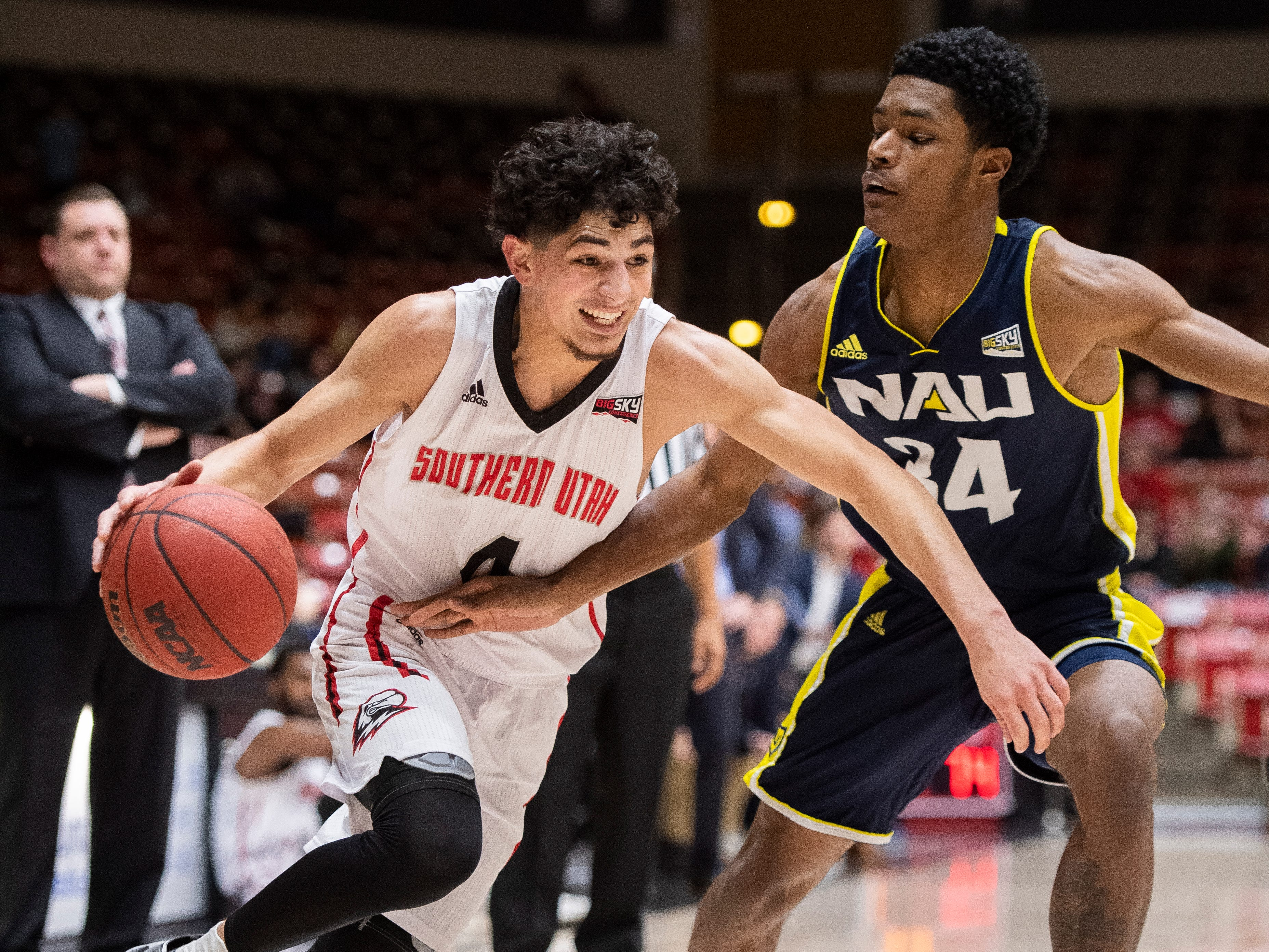 Southern Utah University sophomore Dre Marin (4) pushes towards the basket against rival Northern Arizona at the America First Event Center Saturday, January 12, 2019. SUU won, 84-82.