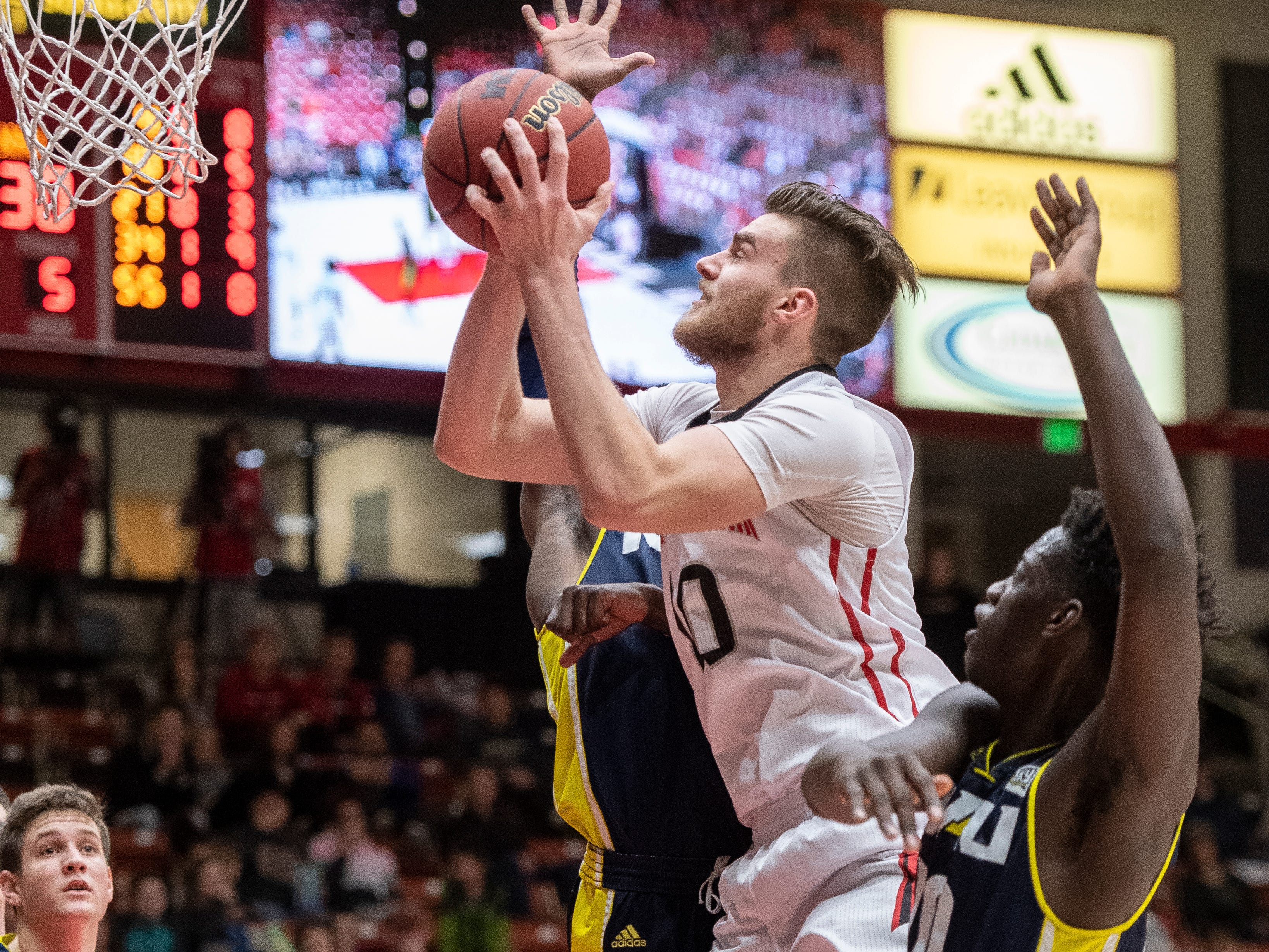 Southern Utah University junior Jacob Calloway (10) scores against rival Northern Arizona at the America First Event Center Saturday, January 12, 2019. SUU won, 84-82.