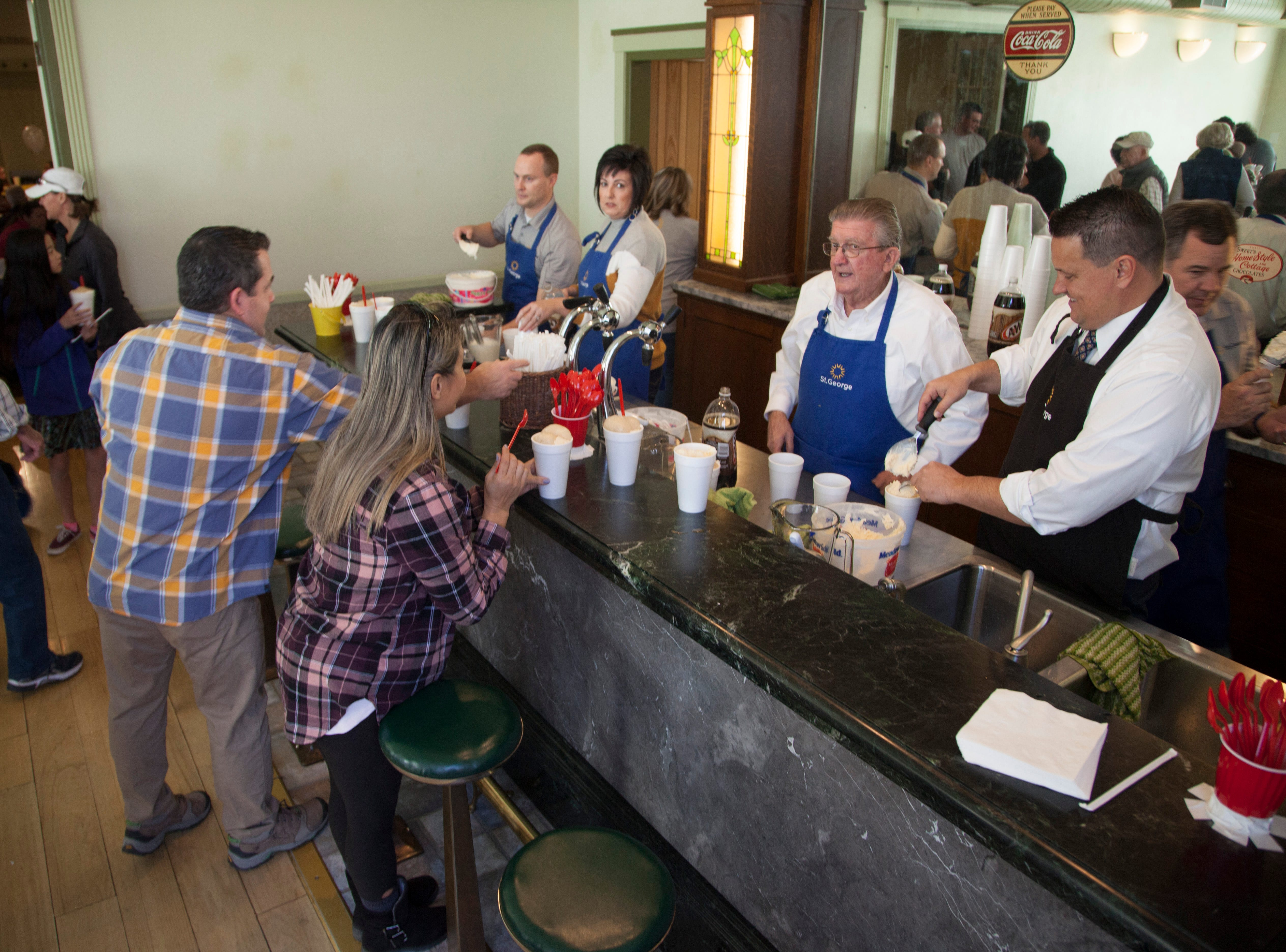St. George City leaders serve cookies and root beer floats at the St. George Social Hall to celebrate the 157th year since the city was established Saturday, Jan. 12, 2019.