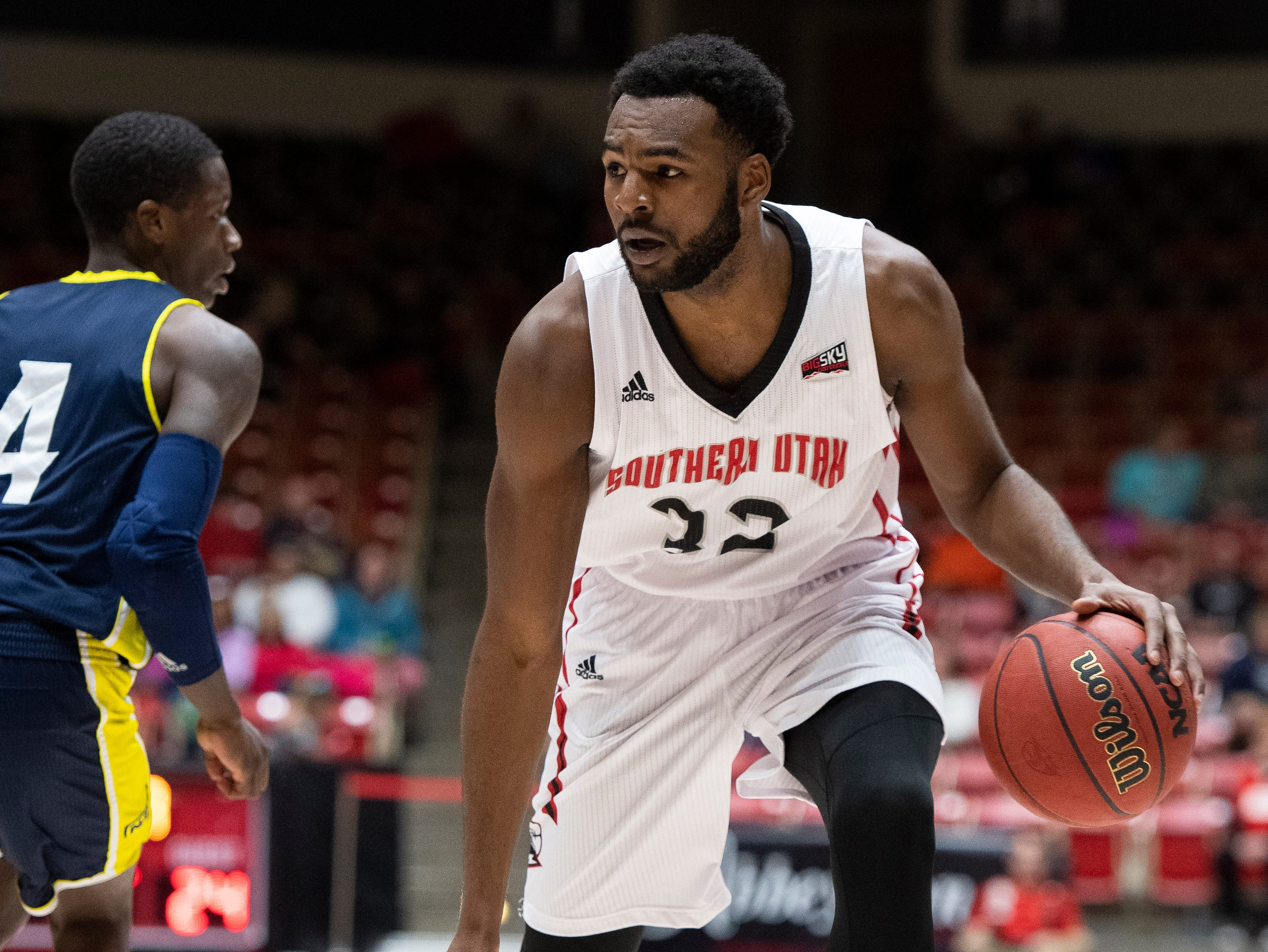 Southern Utah University junior Andre Adams (32) stares down his Northern Arizona opponent at the America First Event Center Saturday, January 12, 2019. SUU won, 84-82.