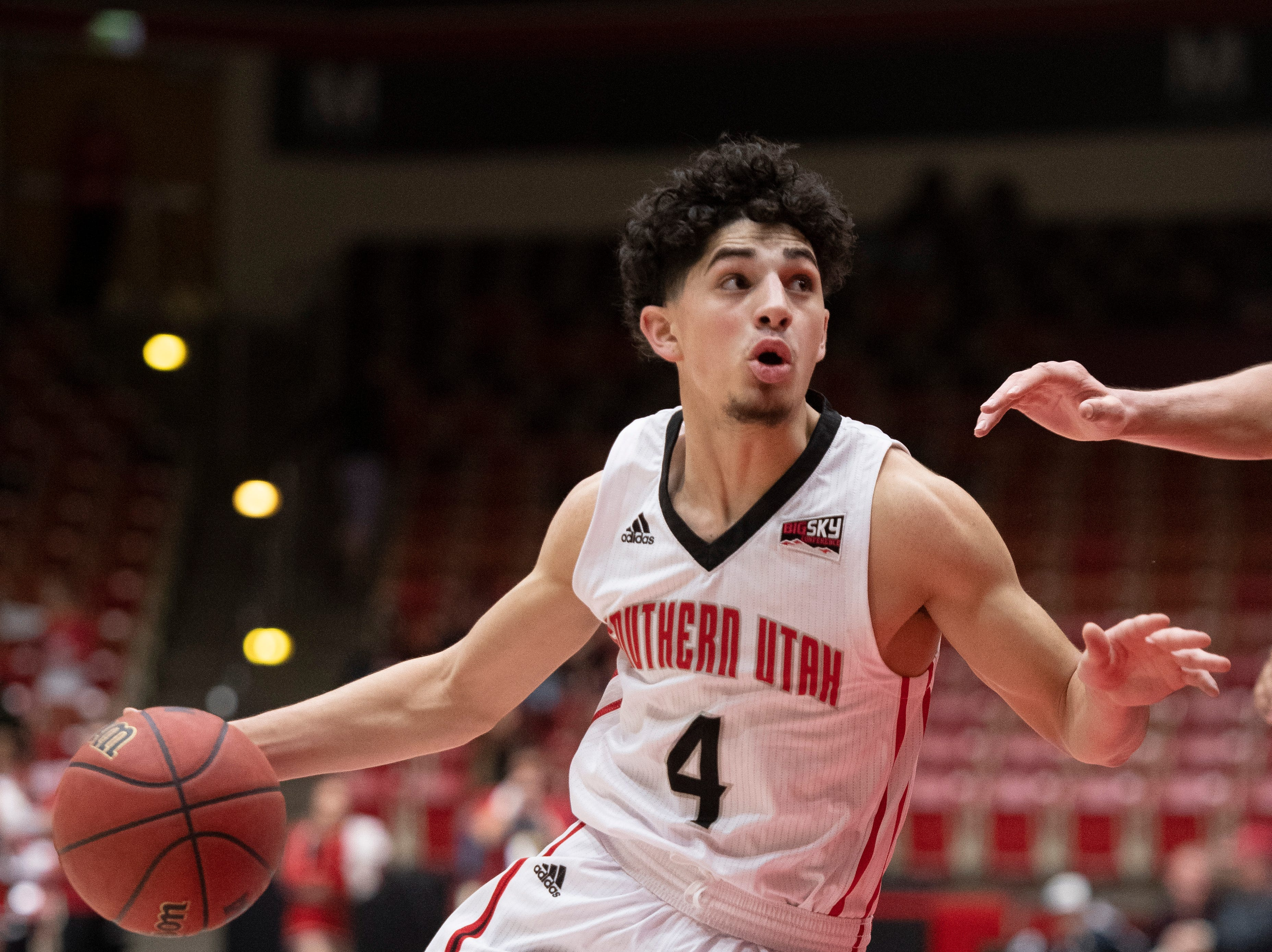 Southern Utah University sophomore Dre Marin (4) runs to the basket against rival Northern Arizona at the America First Event Center Saturday, January 12, 2019. SUU won, 84-82.